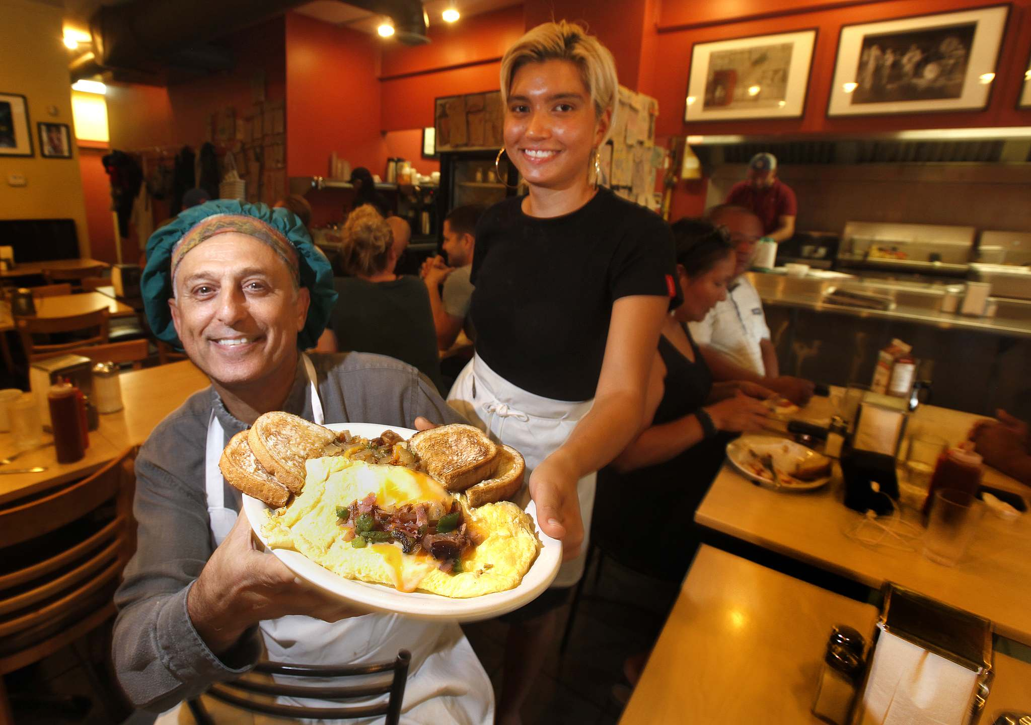 PHIL HOSSACK / WINNIPEG FREE PRESS</p><p>Ami Hassan and Chantel Nygaard show off the Falafel Place's giant Denver omelette.</p>