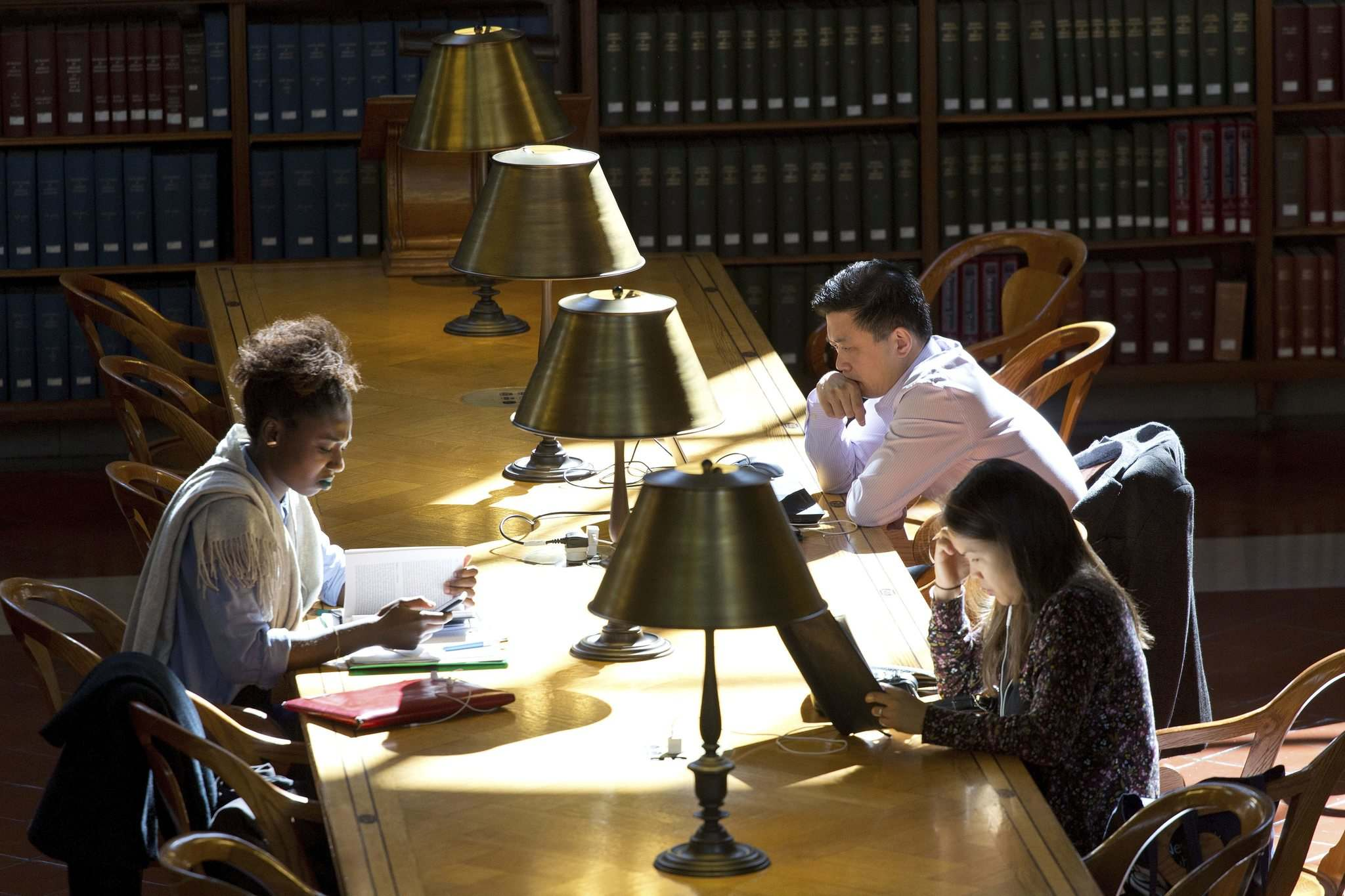 Mark Lennihan / The Associated Press files</p><p>People read at a table as sunlight falls in the Rose Main Reading Room of the New York Public Library</p>
