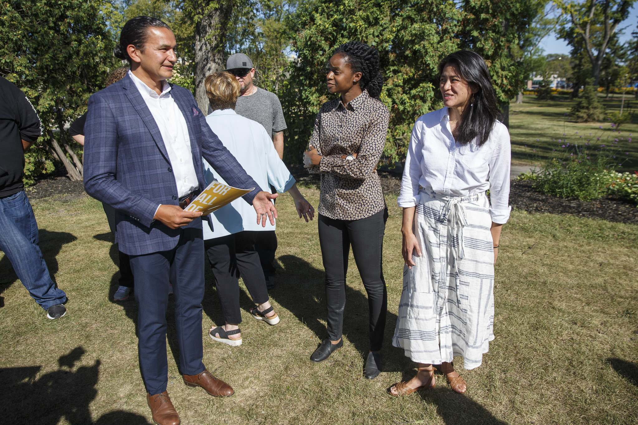 MIKE DEAL / WINNIPEG FREE PRESS</p><p>NDP candidates (from left) NDP Leader Wab Kinew, Uzoma Asagwara (Union Station) and Malaya Marcelino (Notre Dame), during a press conference in Vimy Ridge Park Monday.</p>