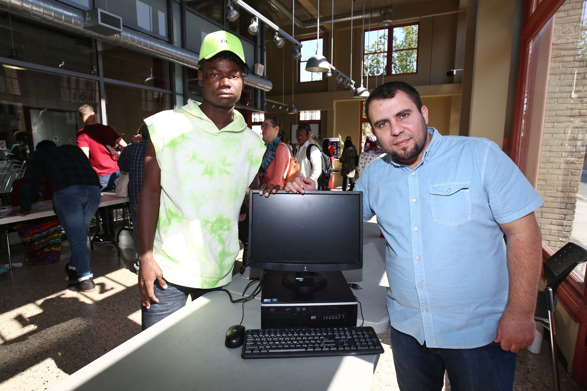 MIKE DEAL / WINNIPEG FREE PRESS</p><p>Teacher Hammoud Jumaa (right) and Nicson Yamondo (left) who is one of the 71 students graduating from Living English for Employment (LEE) at Red River College. He took a computer class as part of the program and now is able to keep it the thanks to Computers for Schools that donated them. </p>