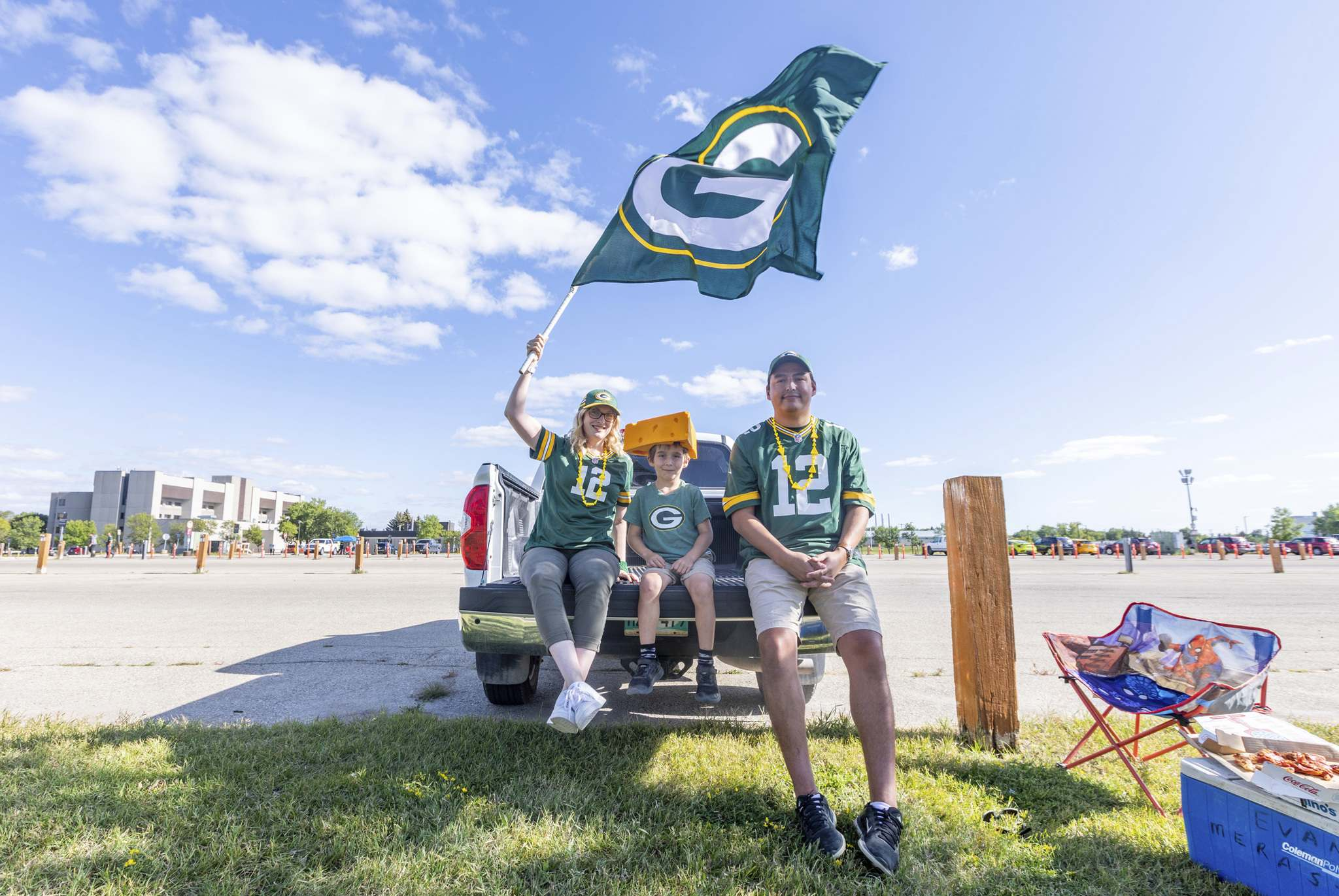 <p>Green Bay Packers die hard fans (from left) Randi, Burke (7) and Tommy Thomas have a parking lot to themselves to do some tailgating before the NFL pre-season game between the Green Bay Packers and Oakland Raiders at IG Field Thursday evening.</p>
