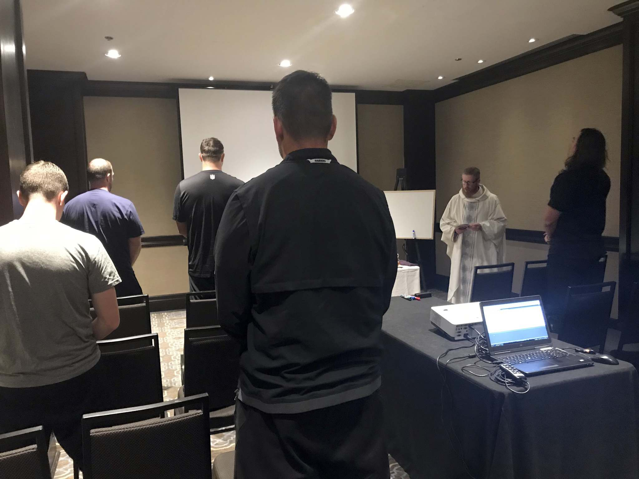 Christian Martinez / Archdiocese of Winnipeg</p><p>Father Kelly Wilson leads the service for the Oakland Raiders at the Fairmont Hotel Wednesday.</p>