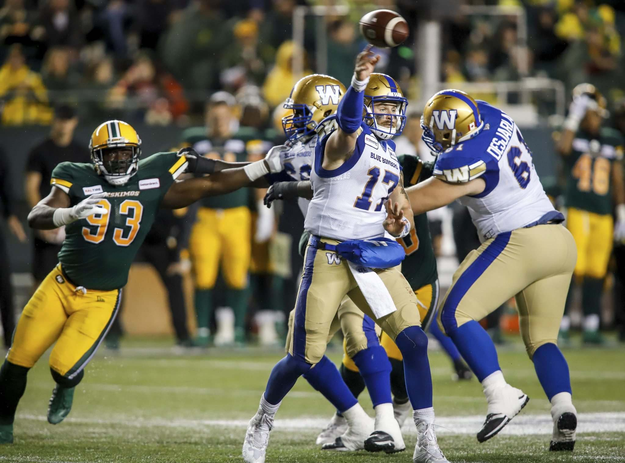 JEFF MCINTOSH / THE CANADIAN PRESS FILES</p><p>Winnipeg Blue Bombers quarterback Chris Streveler, centre, throws the ball as Edmonton Eskimos' Kwaku Boateng closes in during second half CFL football action in Edmonton, Friday, Aug. 23, 2019.</p>