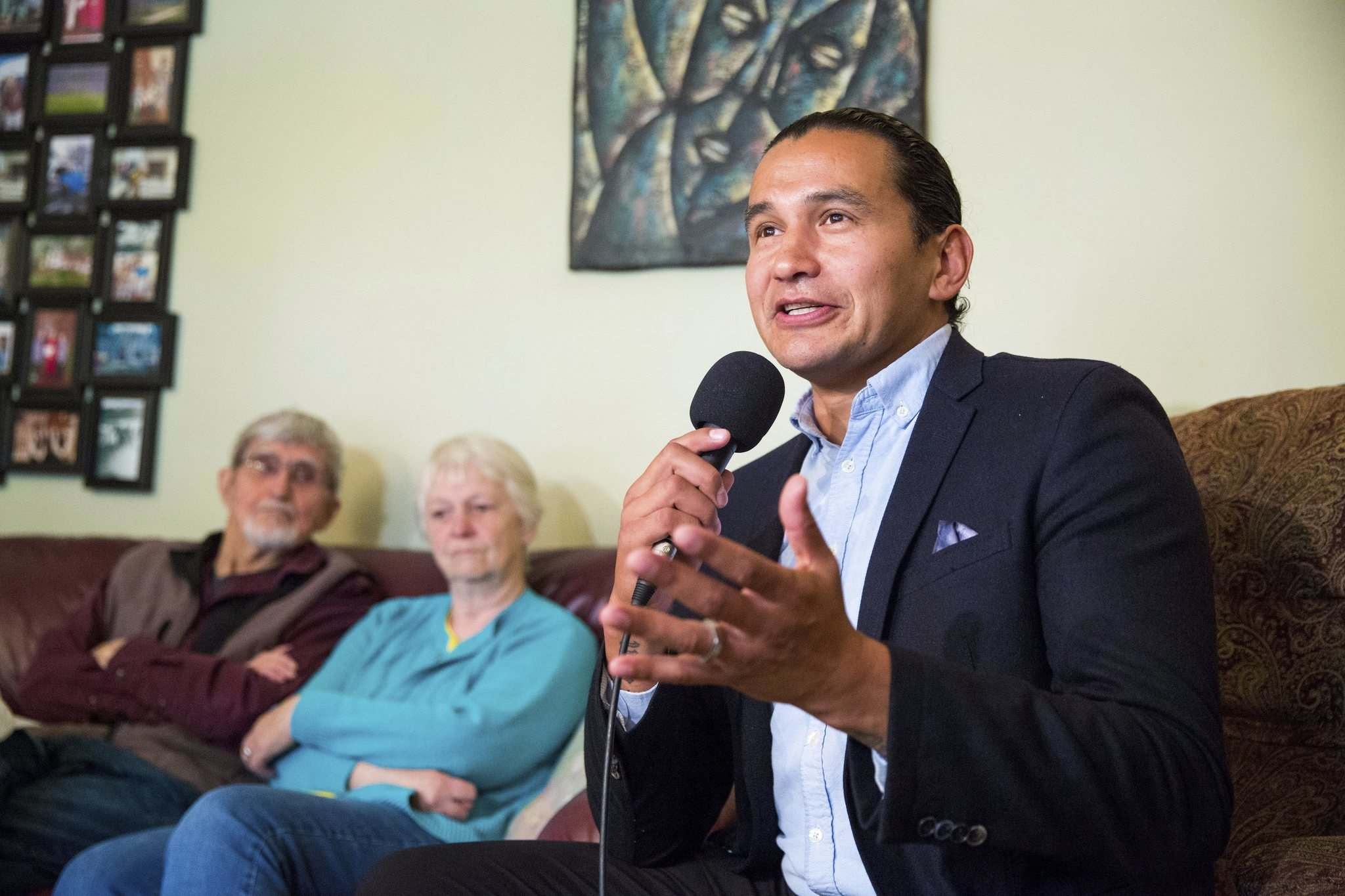 NDP leader Wab Kinew makes a home care announcement with Peter (left) and Esther Hiebert in the couple's home in Winnipeg on Sunday. (Mikaela MacKenzie/ Winnipeg Free Press)