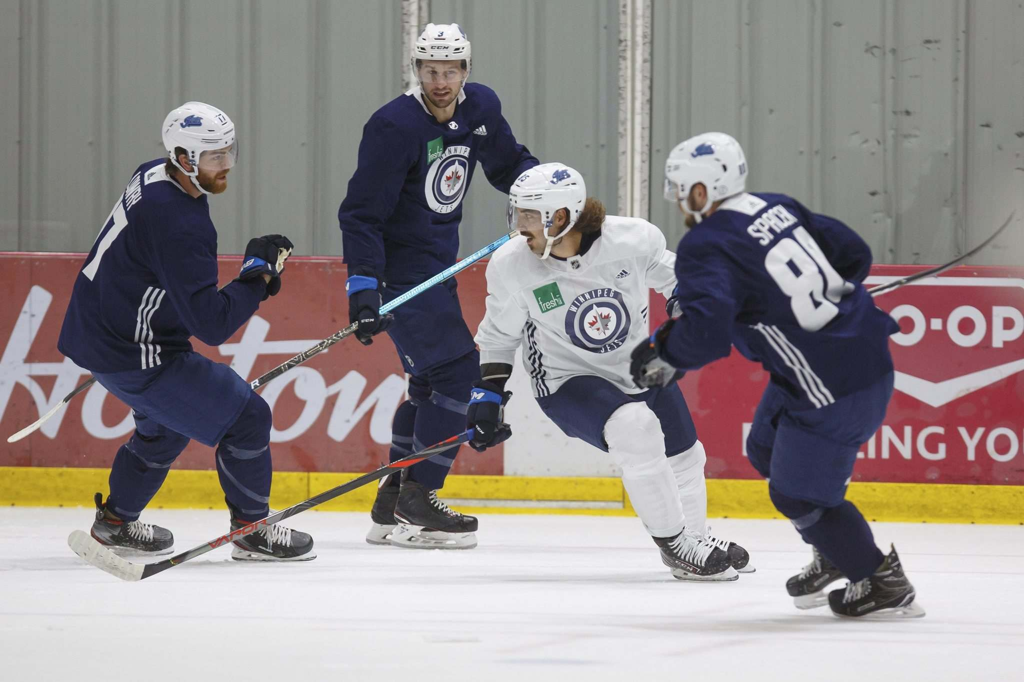 "MIKE DEAL / WINNIPEG FREE PRESS</p><p>Winnipeg Jets Mathieu Perreault, centre, is surrounded by Adam Lowry, Tucker Poolman and Michael Spachek during a morning skate at Bell MTS Iceplex Monday. Perreault is happy to be back in Winnipeg after a rumour-filled off-season dominated by whispers of his imminent departure from the team: ""I'm still with the Jets and that's what I wanted.""</p>"