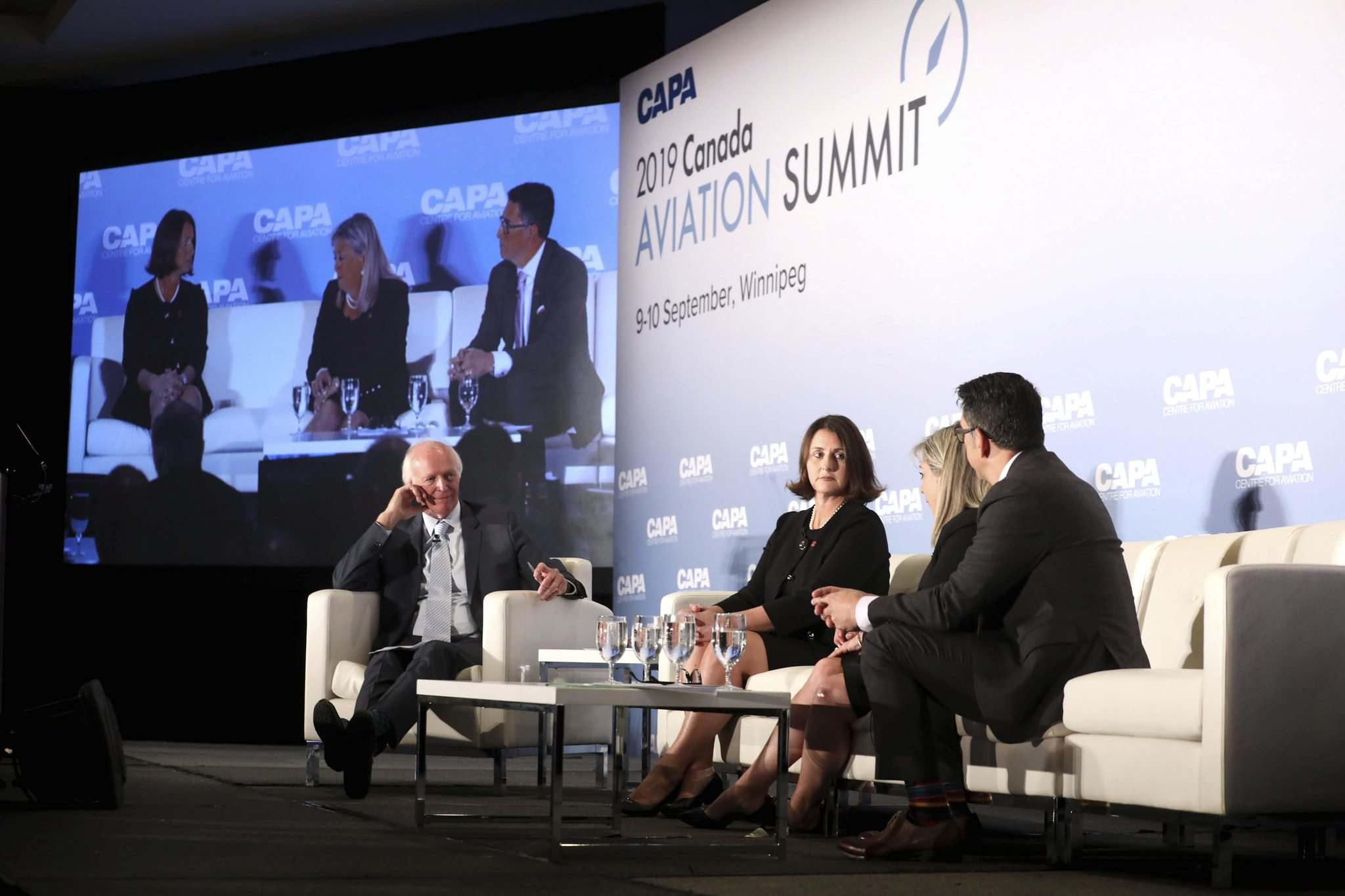 RUTH BONNEVILLE / WINNIPEG FREE fress</p><p>A panel discussion with Peter Harbison (from left), CAPA founder; Catherine Dyer, Air Canada's chief information officer; Lucie Guillemette, Air Canada's executive vice-president and chief commercial officer; and Ferio Pugliese, the senior vice-president in charge of Air Canada Express and government relations, at the Canada Aviation Summit at the Fairmont Hotel on Monday.</p></p>