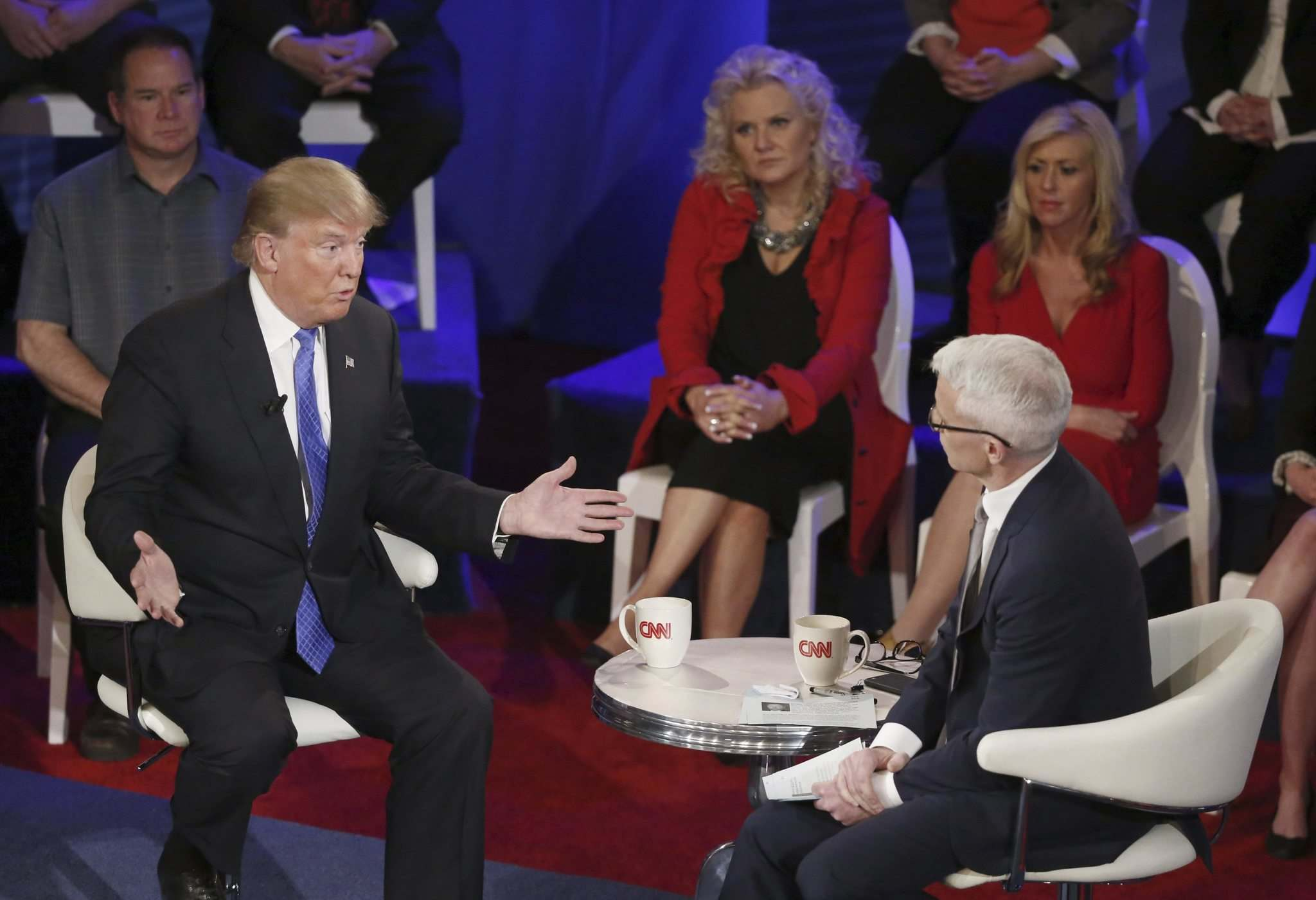 Then-Republican presidential candidate Donald Trump participates in a CNN town hall with Cooper in Milwaukee in 2016. (Charles Rex Arbogast /  Associated Press files)