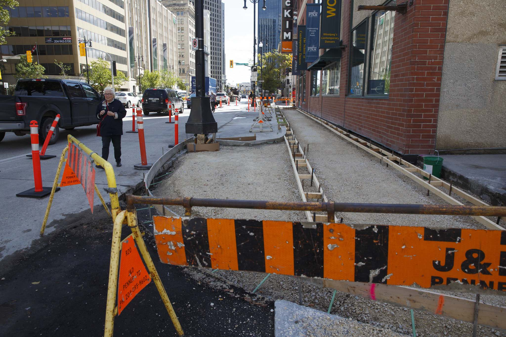 MIKE DEAL / WINNIPEG FREE PRESS</p><p>The Main Street sidewalk that runs along the McKim Building at Main and Bannatyne is getting narrower to make room for a loading zone for the building that was lost when bike lanes were installed on Bannatyne Avenue.</p>