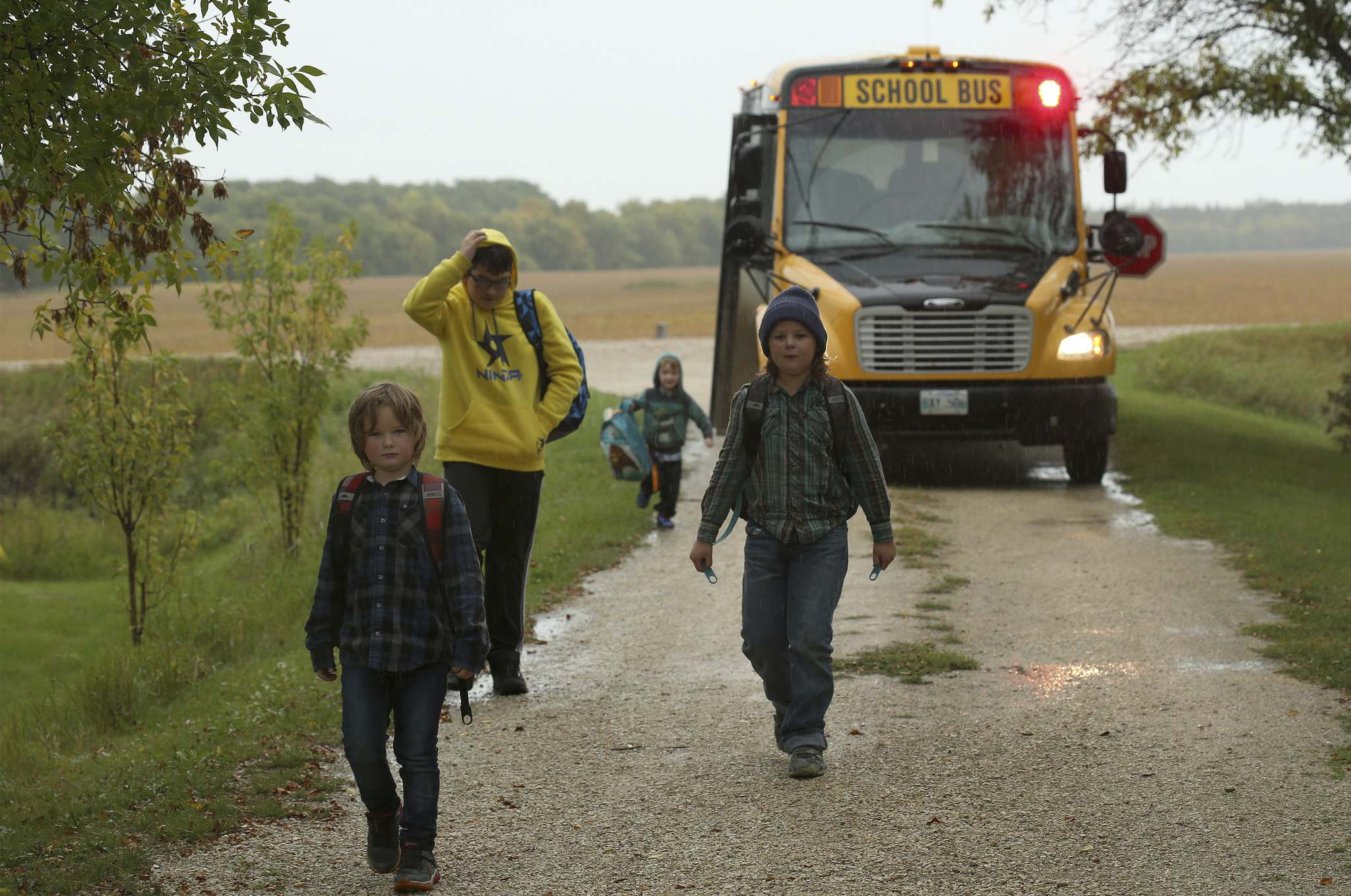 SHANNON VANRAES / WINNIPEG FREE PRESS</p><p>The Thiessen boys are dropped off at the end of the school day.</p>