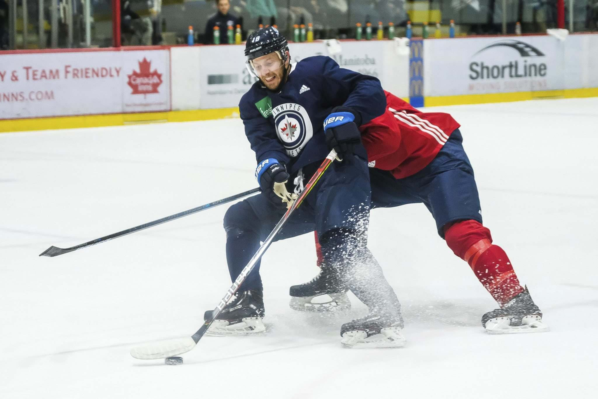 "DANIEL CRUMP / WINNIPEG FREE PRESS</p> <p>Jets forward Bryan Little handles the puck during a training camp session on Saturday at the Iceplex. Training camp continues today before the team heads to Edmonton for a pre-season tilt against the Oilers.</p> </p> <p>""></a><figcaption readability="