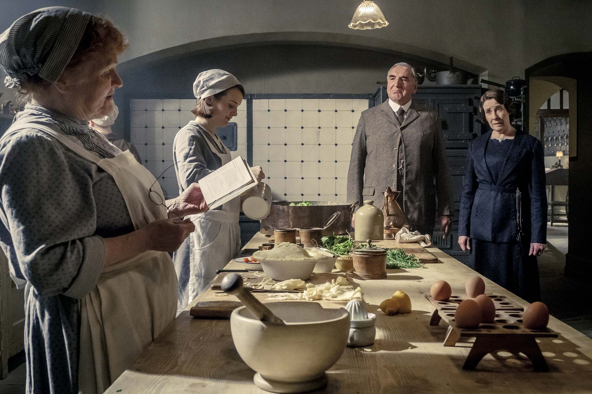 Lesley Nicol (from left), Sophie McShera, Jim Carter and Phyllis Logan all return in the Downton Abbey movie. (Jaap Buitendijk / Focus Features)