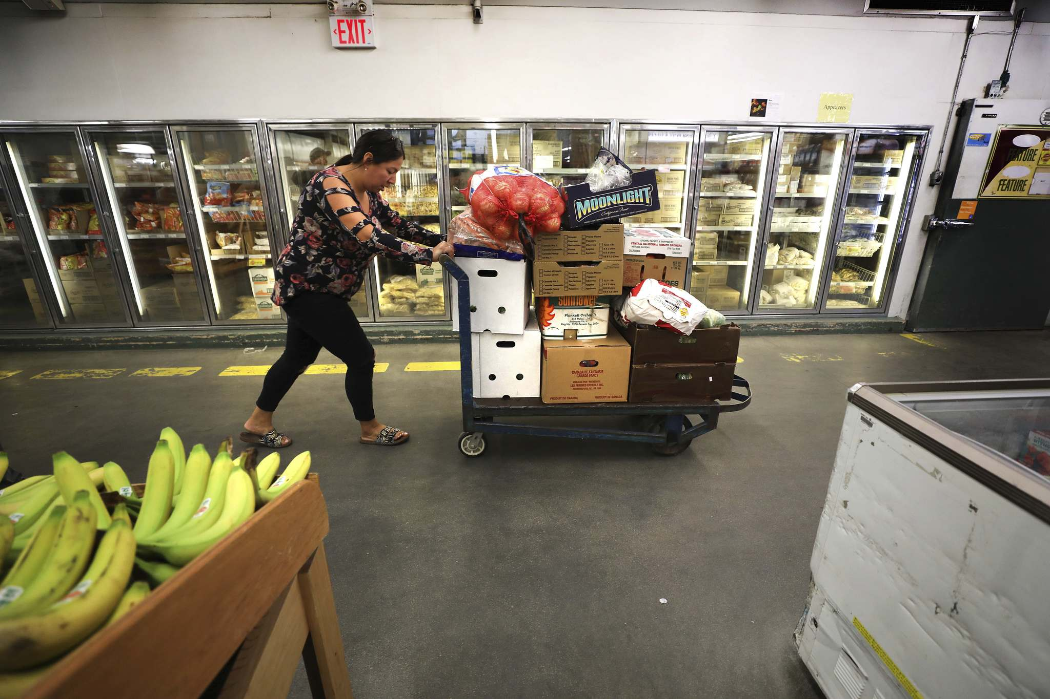 McDonald heads out of Sobeys with a dolly full of boxes of fresh food.</p>