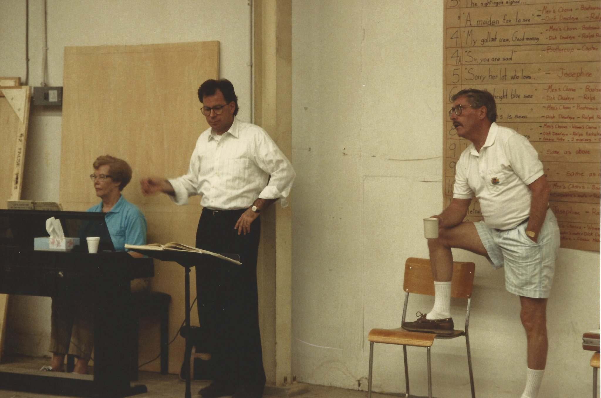 SUPPLIED</p><p>In 1993, Margaret Harrison (from left) with conductor Carlisle Wilson (conductor for first seven Gilbert & Sullivan Society shows) and husband Glen Harrison in rehearsal for H.M.S. Pinafore.</p>
