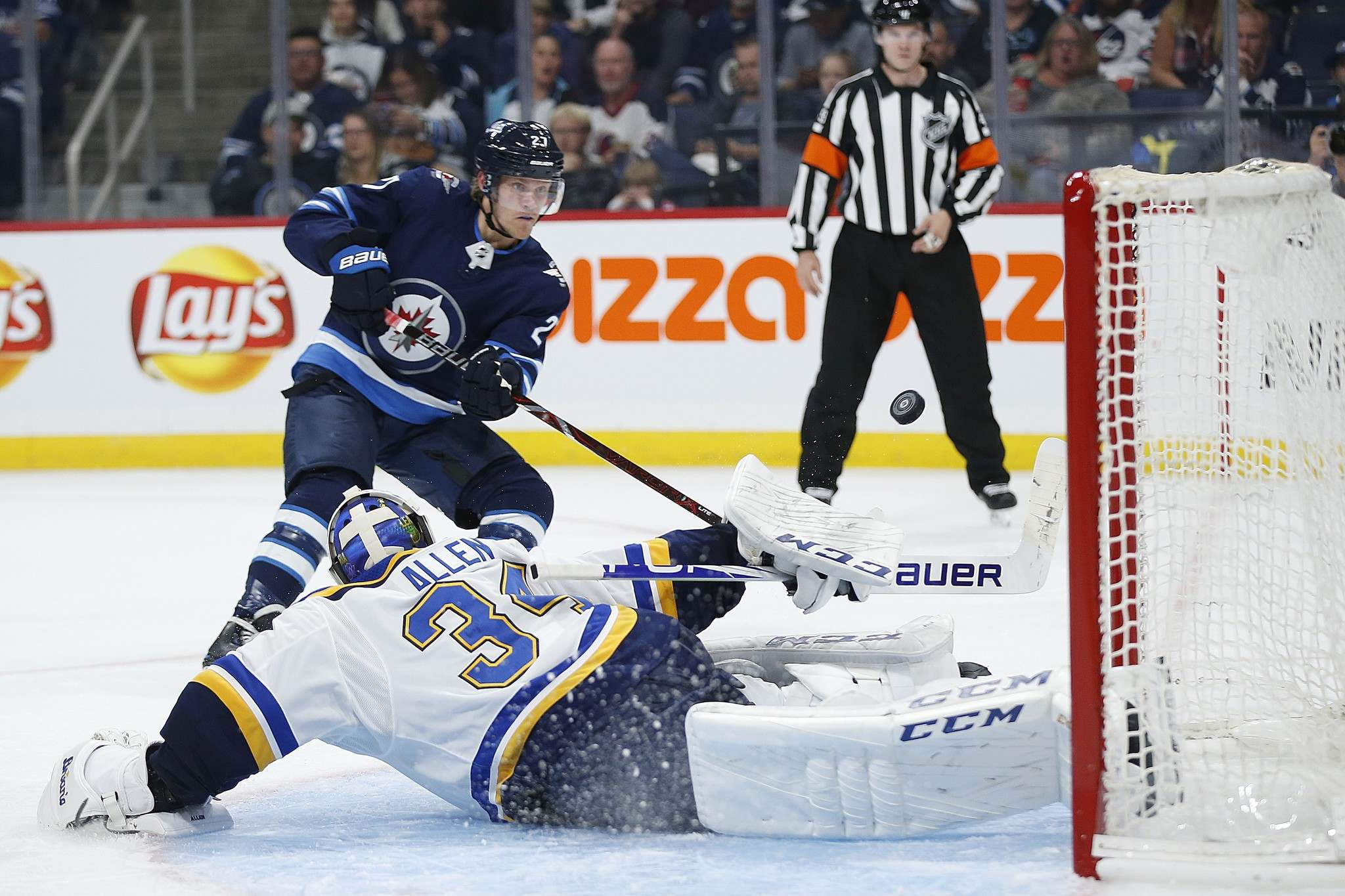 <p>Jets forward Nikolaj Ehlers fires a shot on Blues goaltender Jake Allen during Friday's NHL pre-season game at Bell MTS Place. Adam Lowry scored after the shot hit the crossbar.</p></p>