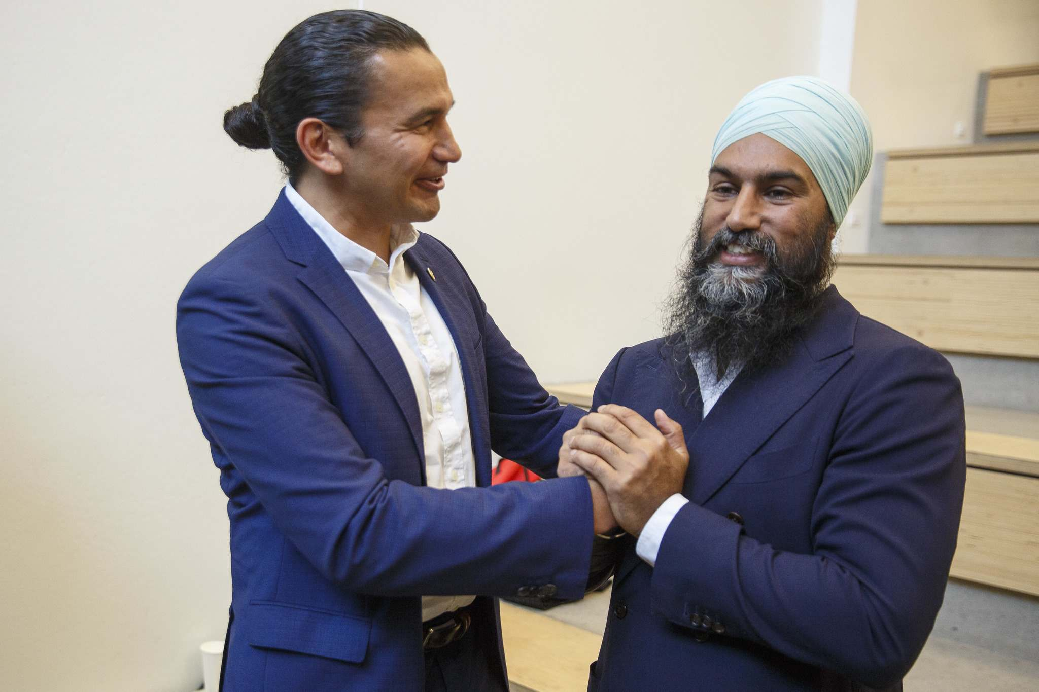 Provincial NDP Leader Wab Kinew chats with federal NDP Leader Jagmeet Singh Tuesday after Singh announced the NDP's plan to address the climate crisis and create green jobs during a stop at the University of Winnipeg. (Mike Deal / Winnipeg Free Press)</p>