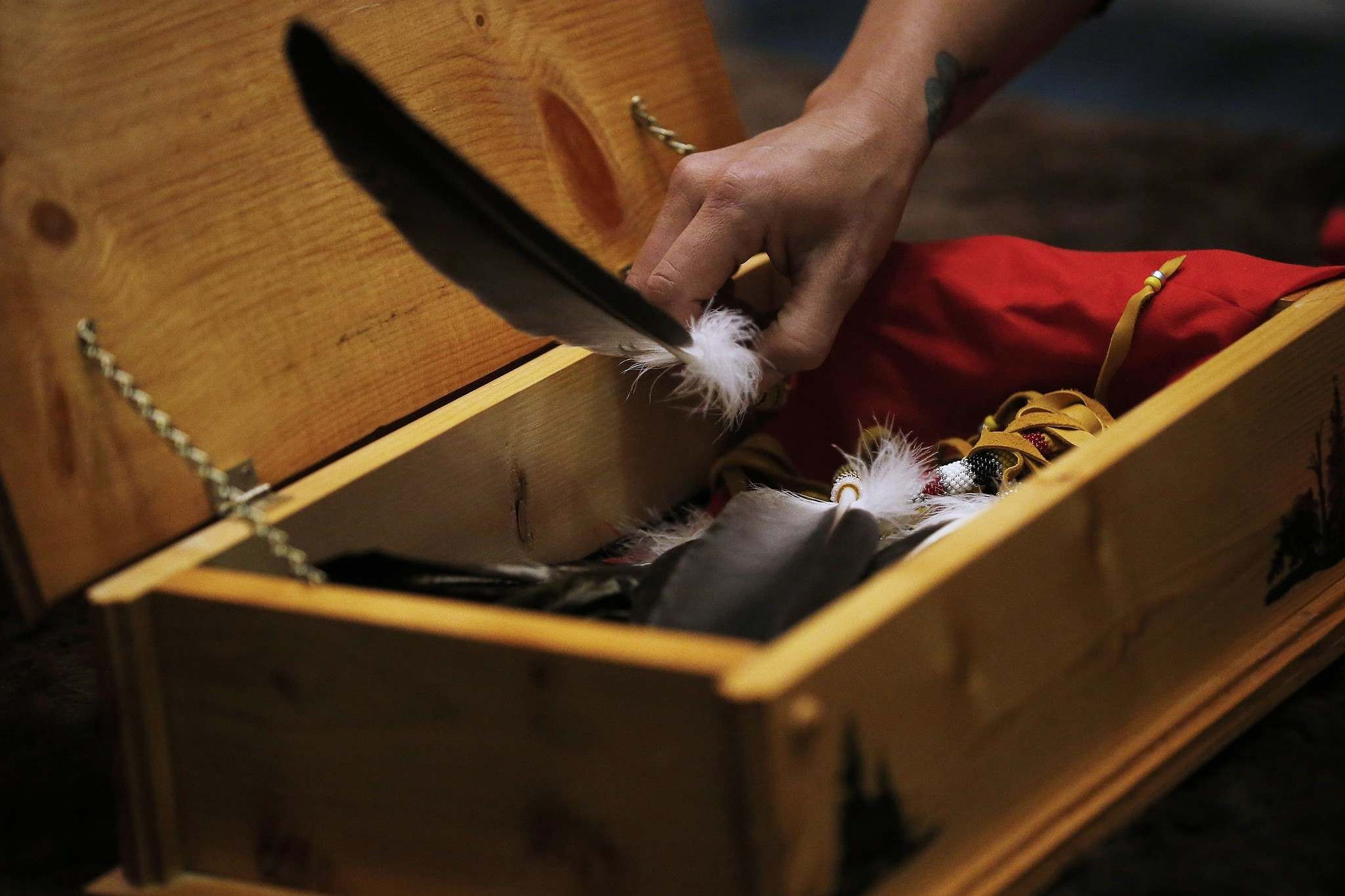 An eagle feather is not something you take or buy, but something gifted to you. Feathers are designed to build community, which is why elders say they have two sides and a spine. (John Woods / The Canadian Press files)</p>