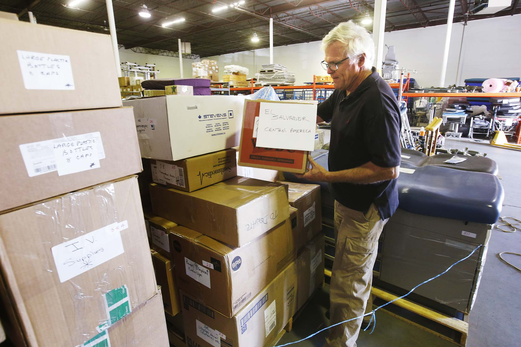 <p>Kevin Stewart, president of International Hope Canada, prepares a load of reclaimed medical equipment and supplies destined for El Salvador Tuesday. The organization is losing it's warehouse and needs a new space to work out of.</p>