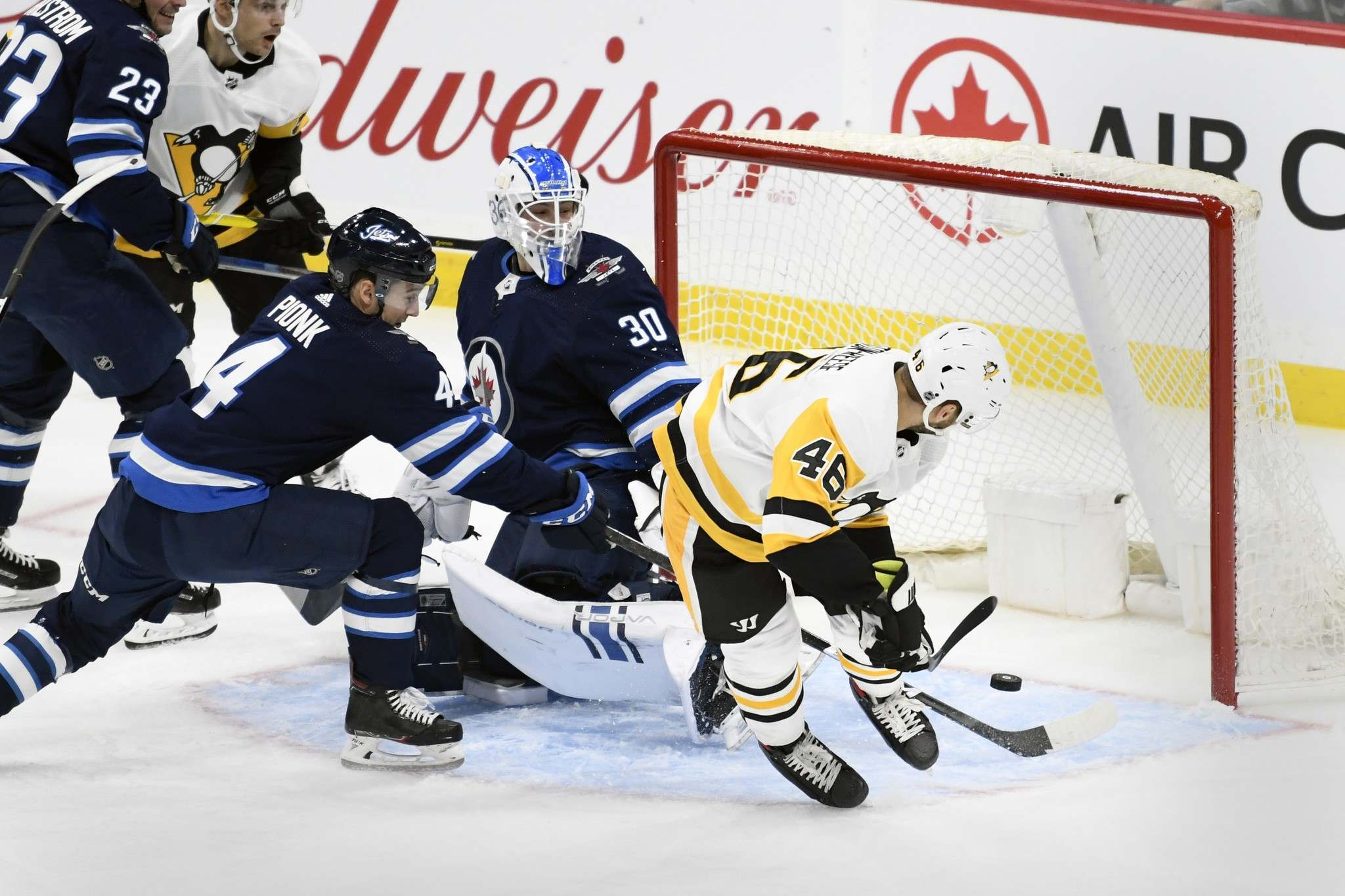 Zach Aston-Reese scores his first of two goals Sunday during the Penguins 7-2 victory over the Jets. (Fred Greenslade / The Canadian Press)</p>