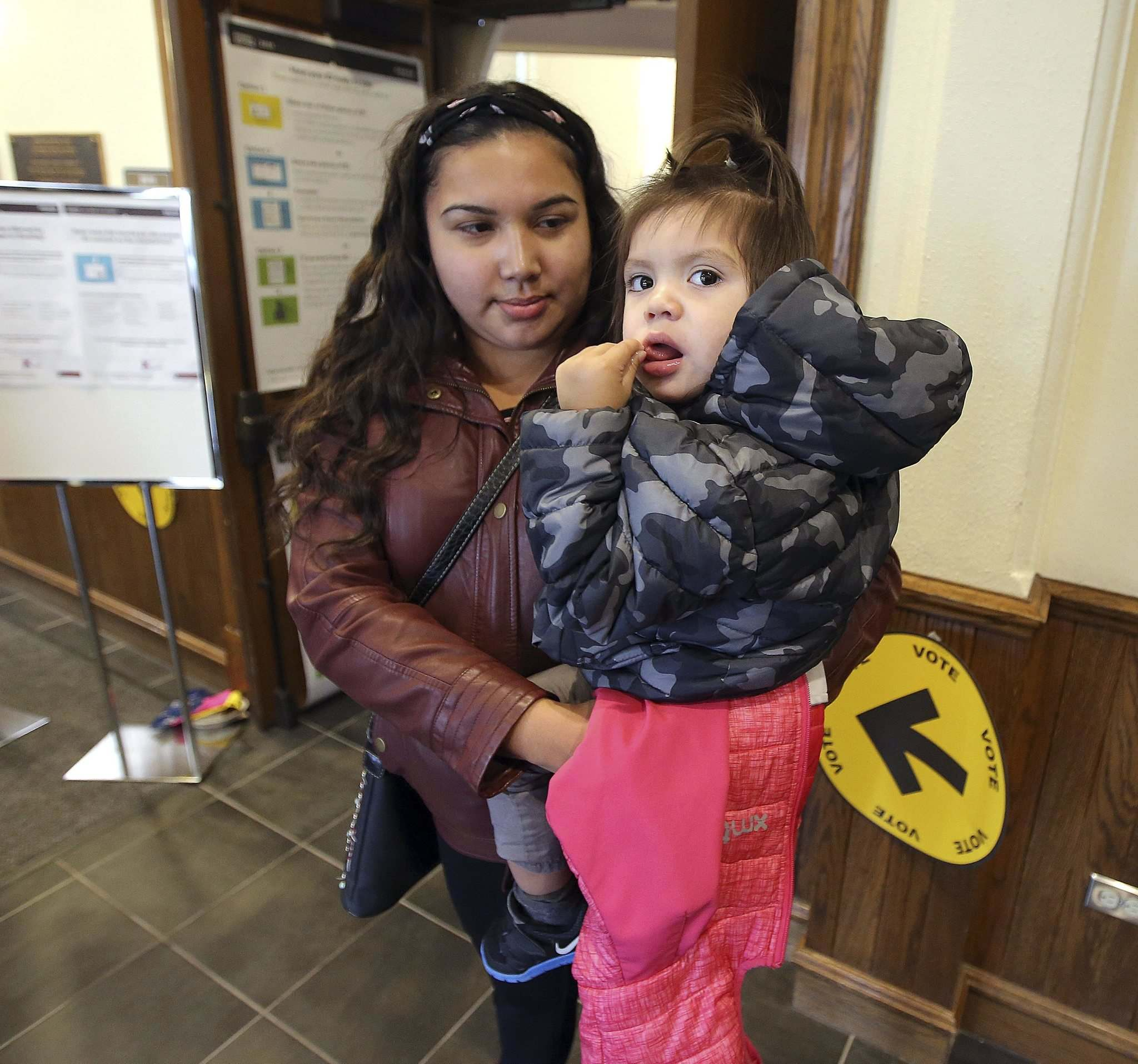</p><p>Christina Sutherland of Pinaymootang (Fairford) First Nation leaves with her child, Noah, 1, after voting Monday at a special polling station at the University of Winnipeg for those displaced by the big storm. (Jason Halstead / Winnipeg Free Press)</p>