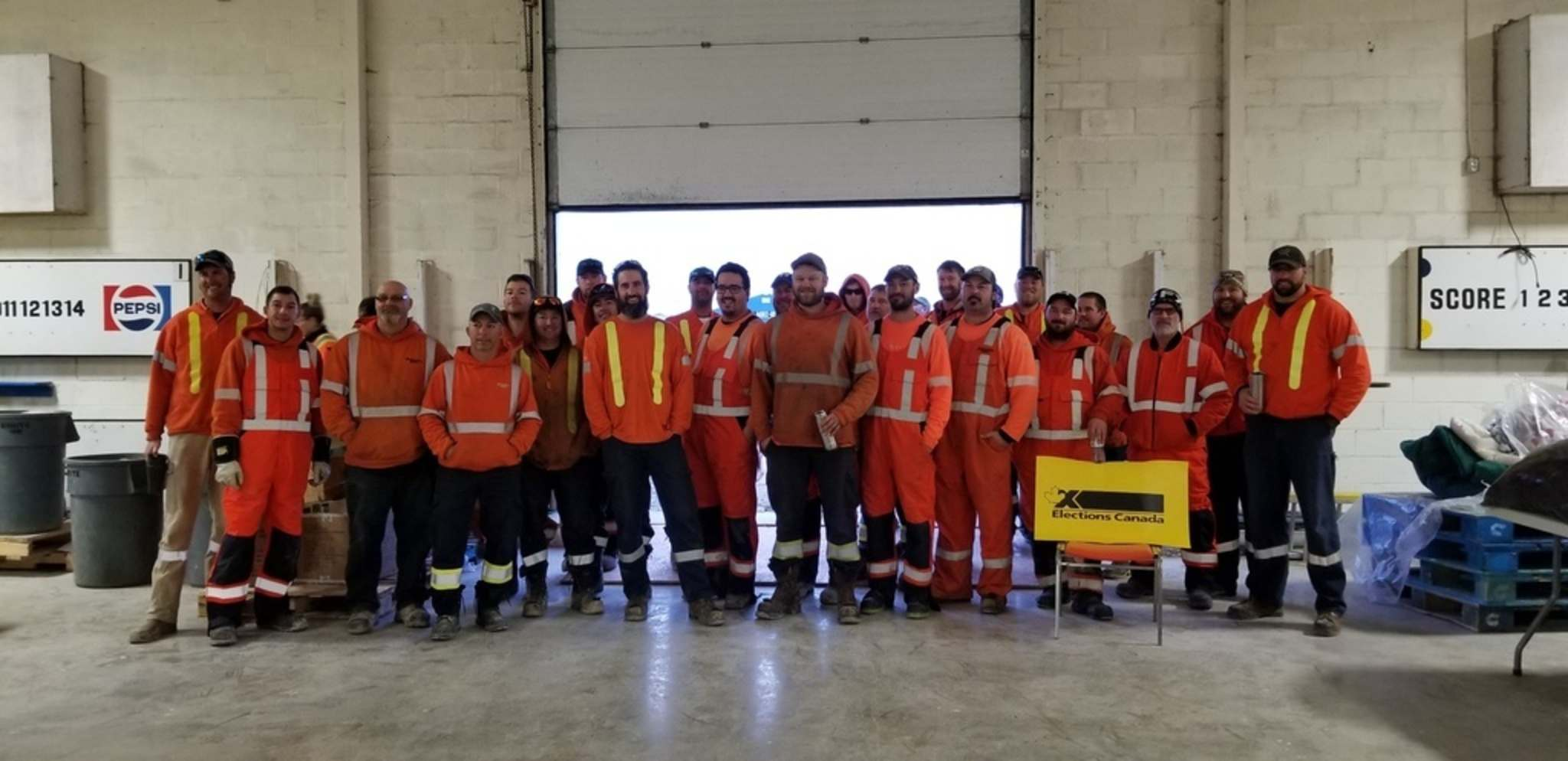 Manitoba Hydro workers after voting at the polling station set up in Lundar on Monday. (Supplied)</p>