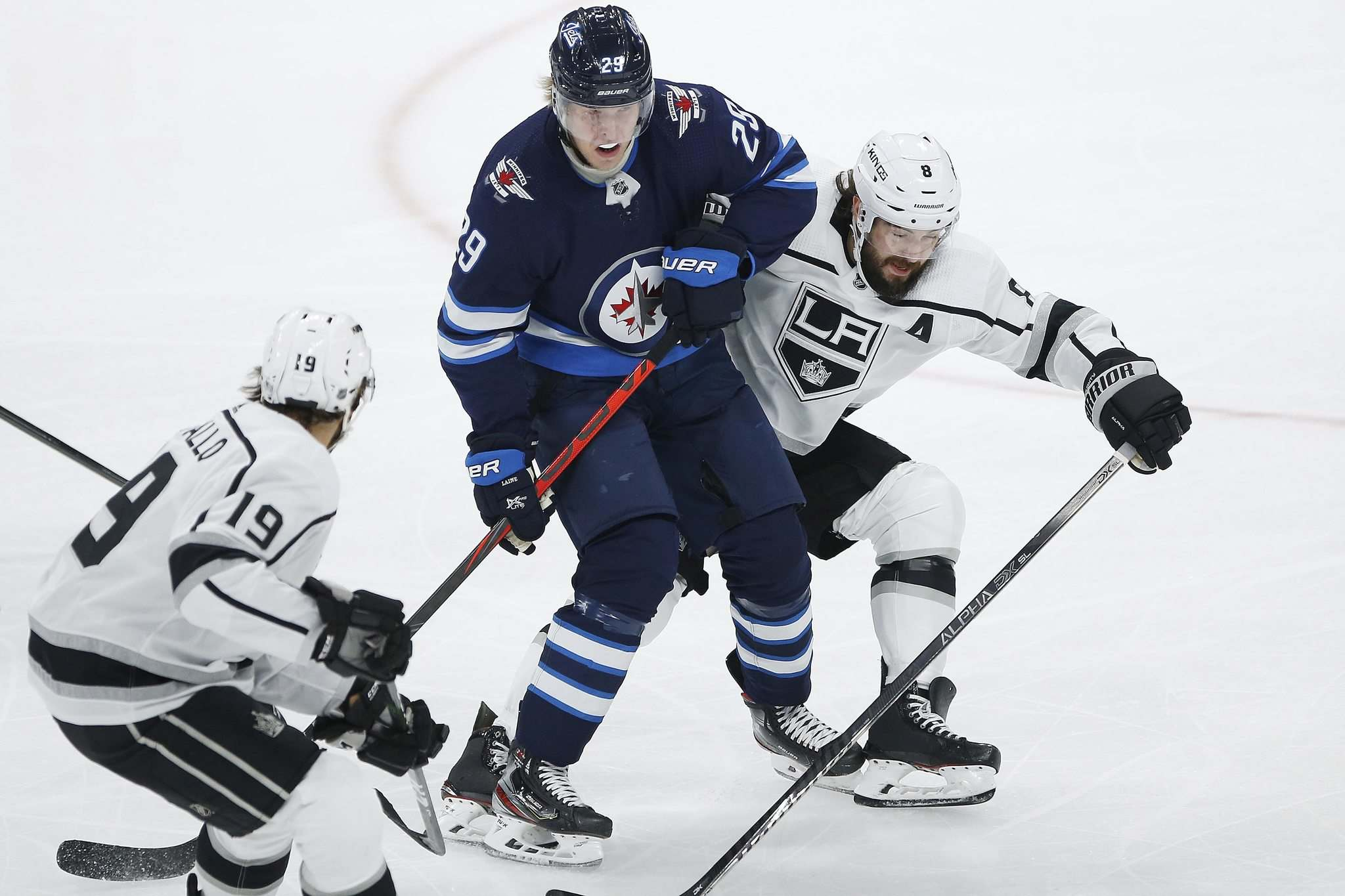 JOHN WOODS / WINNIPEG FREE PRESS</p><p>Kings defenceman Drew Doughty (right) and teammate Alex Iafallo tie up Jets forward Patrik Laine during Tuesday night's game at Bell MTS Place. Doughty admits to holding grudges against certain players.</p>