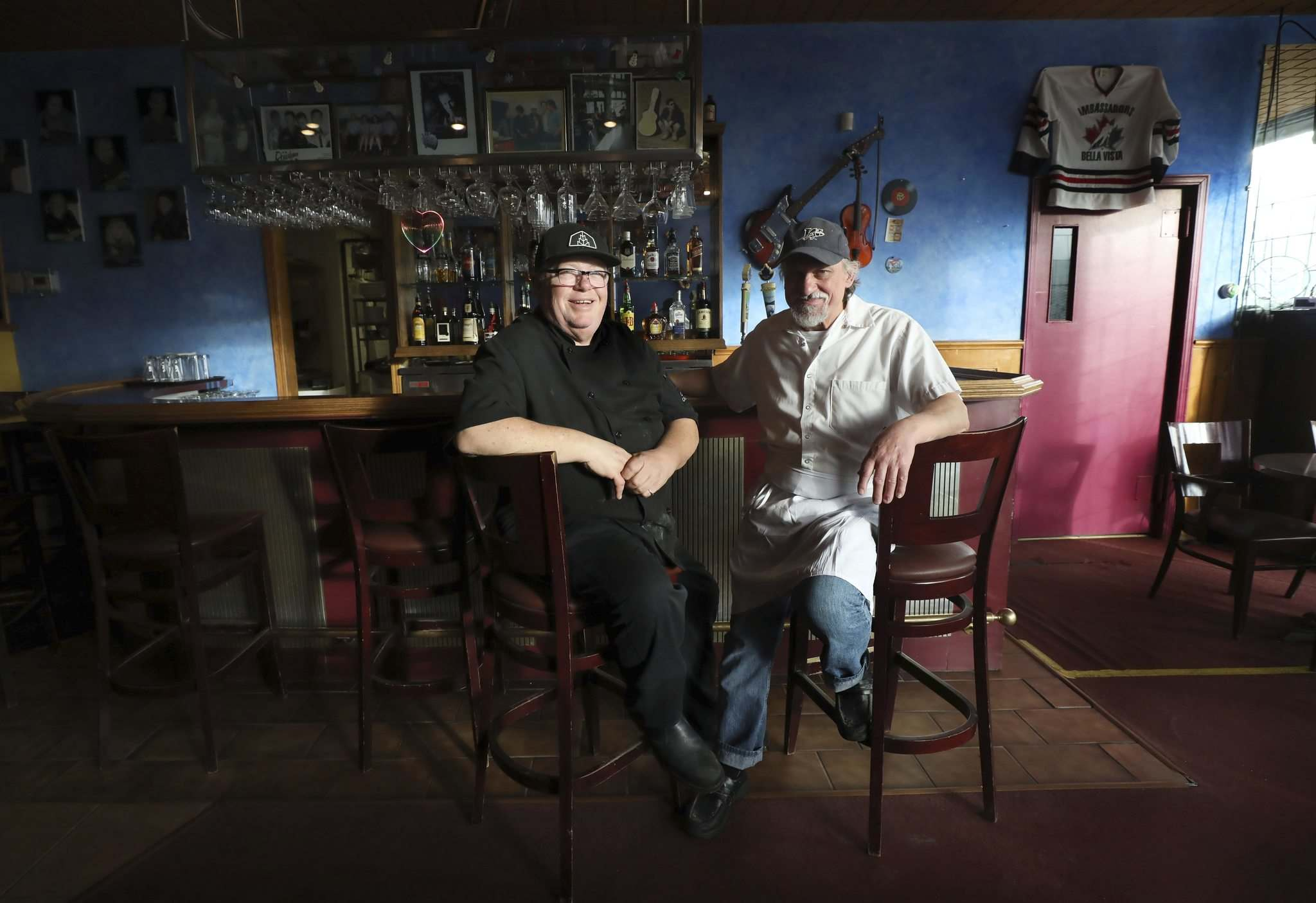 Colosimo (right) sold the Bella Vista to Jeffers, who will keep the Italian menu, but add breakfast and lunch options, along with an expanded beer selection. (Ruth Bonneville / Winnipeg Free Press)