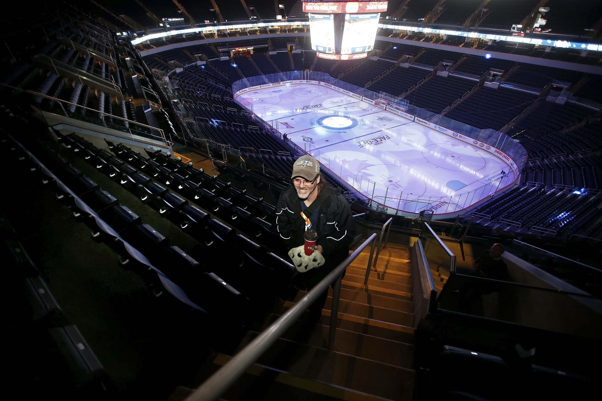 JOHN WOODS / WINNIPEG FREE PRESS</p><p>Eccles climbs the stairs to the top row of Section 317, where the organist's 'hobbit hole' is located.</p>
