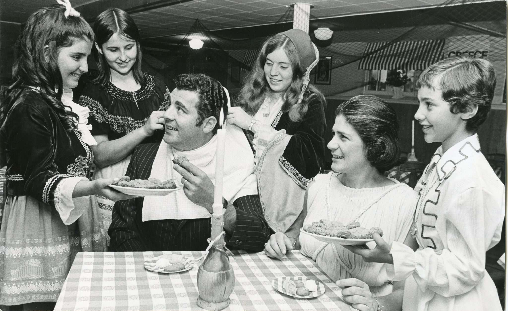 WINNIPEG FREE PRESS FILES</p><p>Honorary Greek consul Michael Mercury gets the royal treatment at the Greek pavilion at Folklorama in August 1971. Surrounding him are Anita Vardalos (from left), Mary Tsouras, Georgia Carabelas, Mary Kelekis and Athena Anadranistakis.</p></p>
