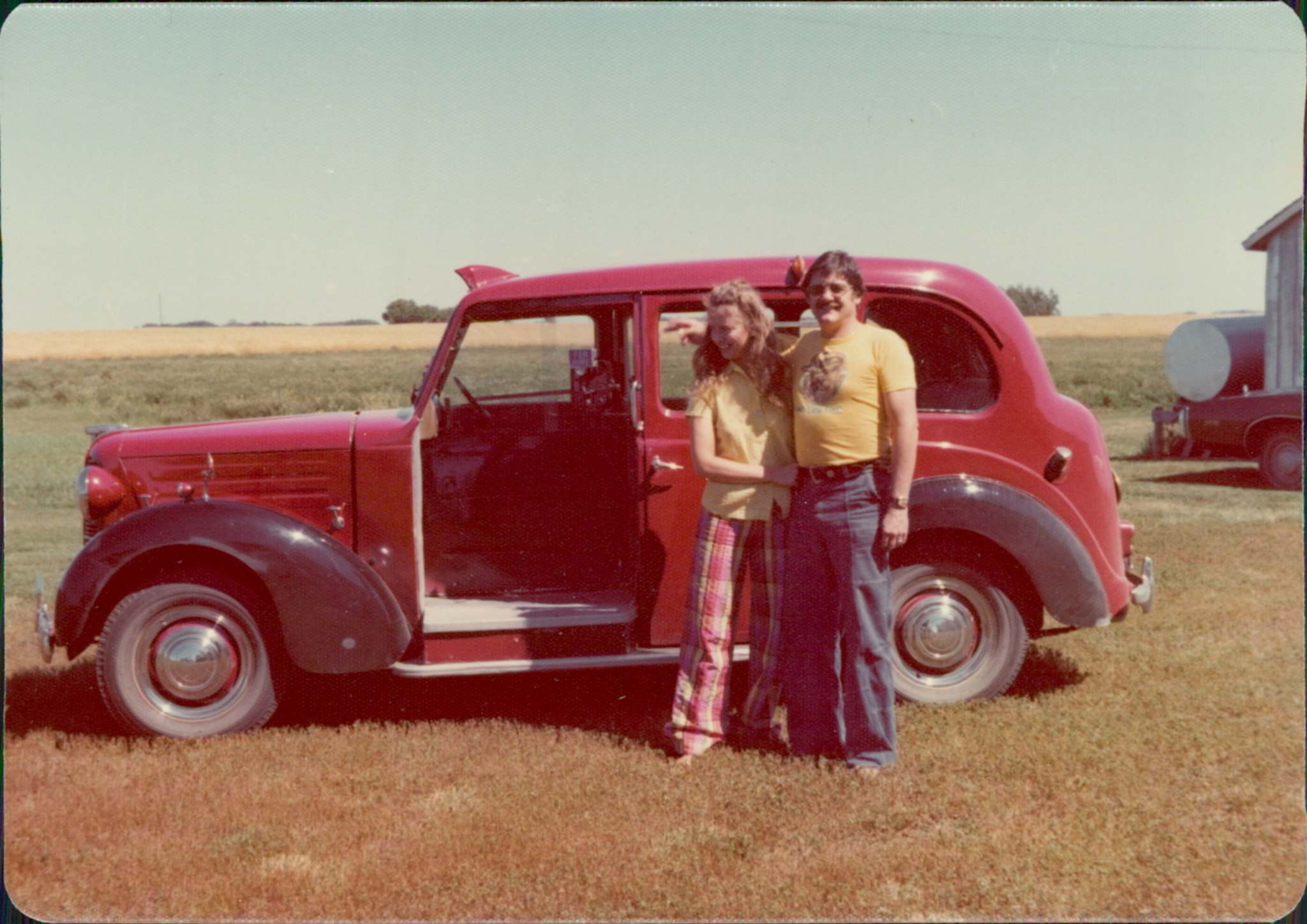 Supplied</p><p>Margaret Kentner (left) with her partner, Peter, and her British taxi in 1976.</p></p>