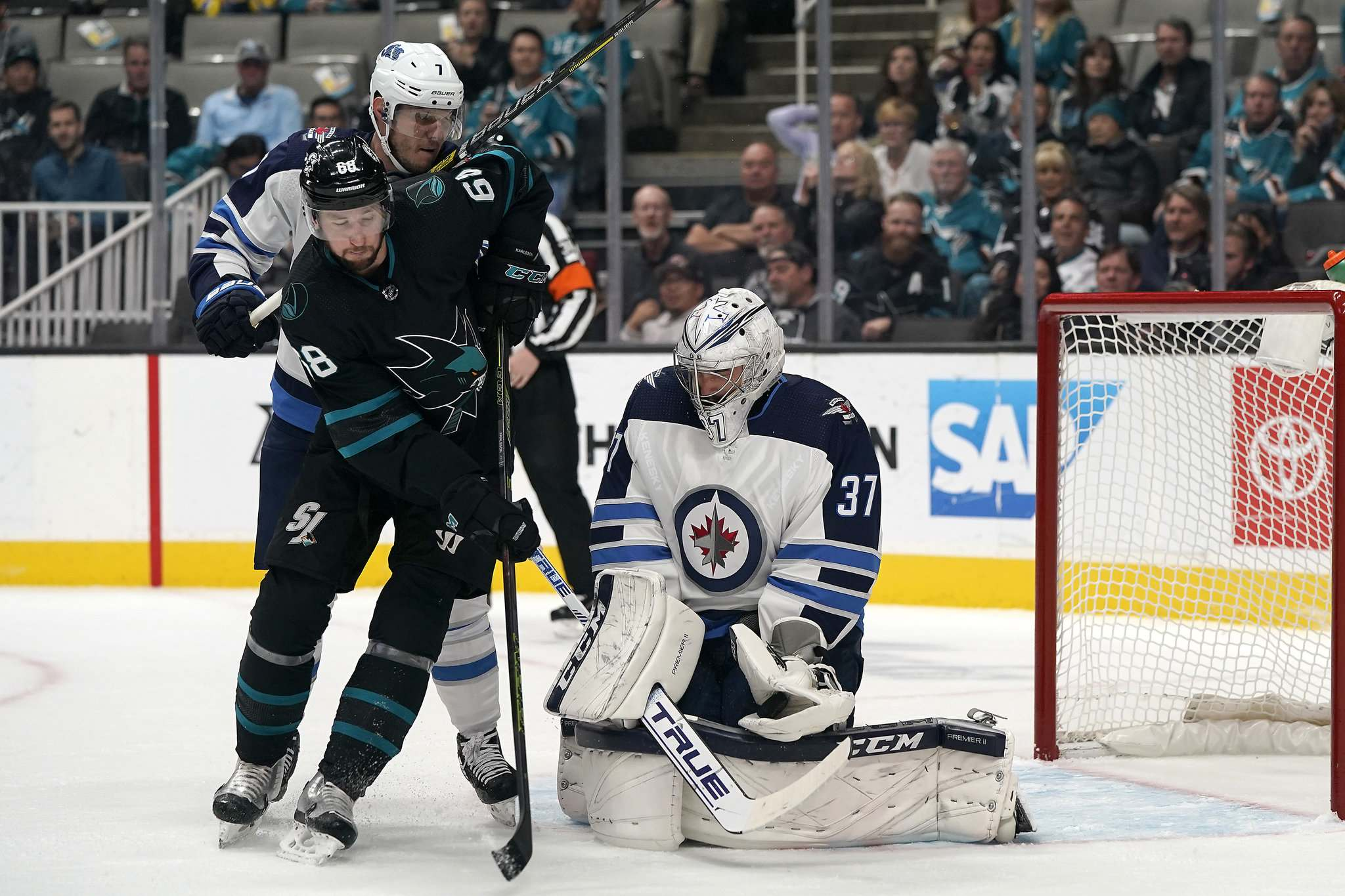 (AP Photo/Tony Avelar)</p><p>Winnipeg Jets goaltender Connor Hellebuyck stops a shot from San Jose Sharks centre Melker Karlsson during the first period in San Jose, Calif., Friday.</p>