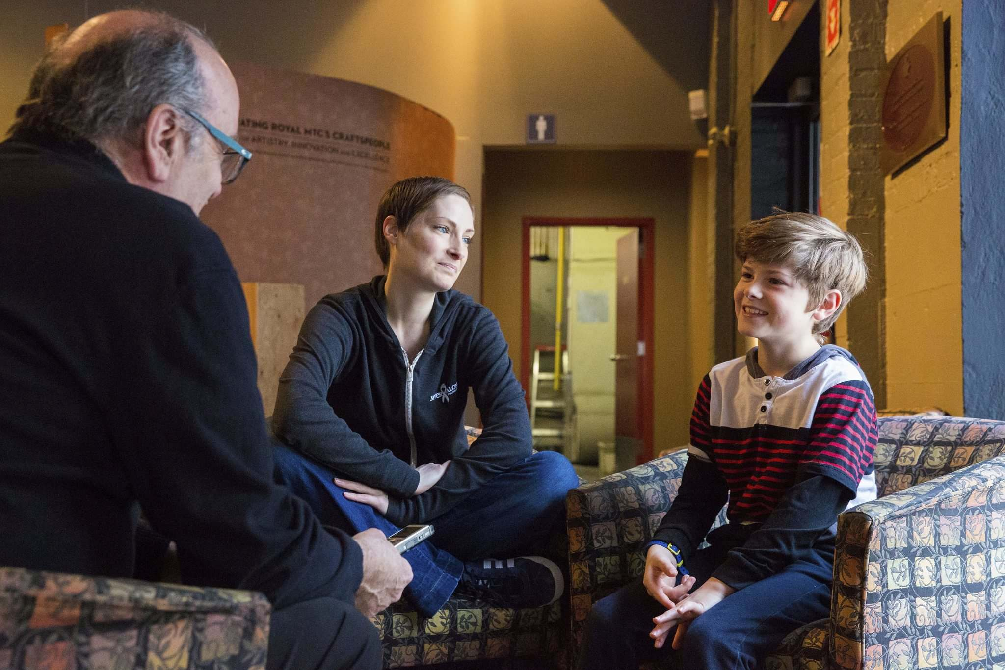 MIKAELA MACKENZIE / WINNIPEG FREE PRESS</p><p>Wreford and her son, Elliot, took a break from rehearsal and sat down to speak with Free Press arts reporter Randall King (left) at the Tom Hendry Warehouse Theatre lobby.</p></p>