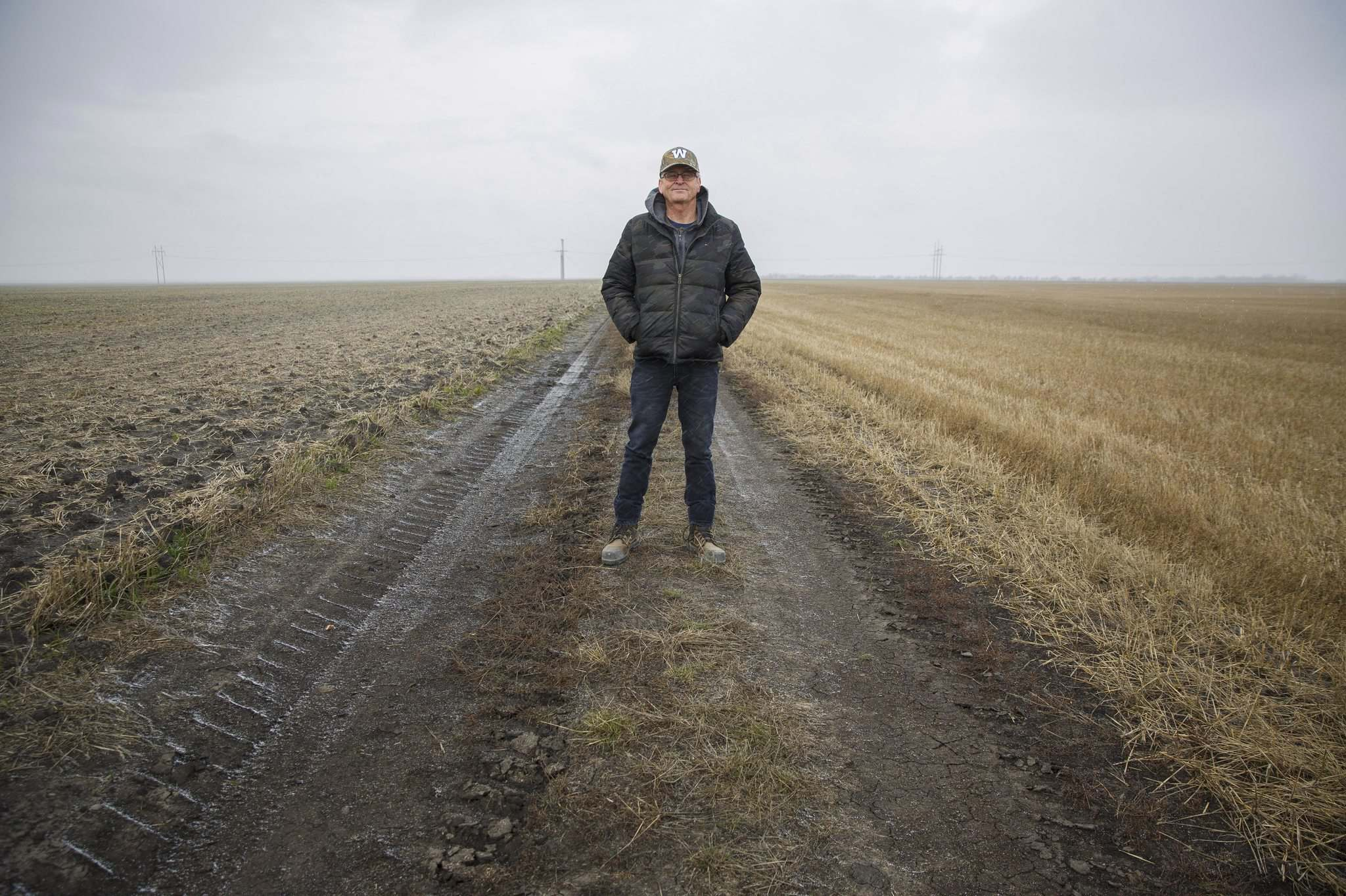 Emerson-area farmer Robert Milne owns the small parcel of land known as the Airport Quarter. Planes landed on the left side of the road, in the U.S., before being dragged into Canada (on the right). (Mike Deal / Winnipeg Free Press)
