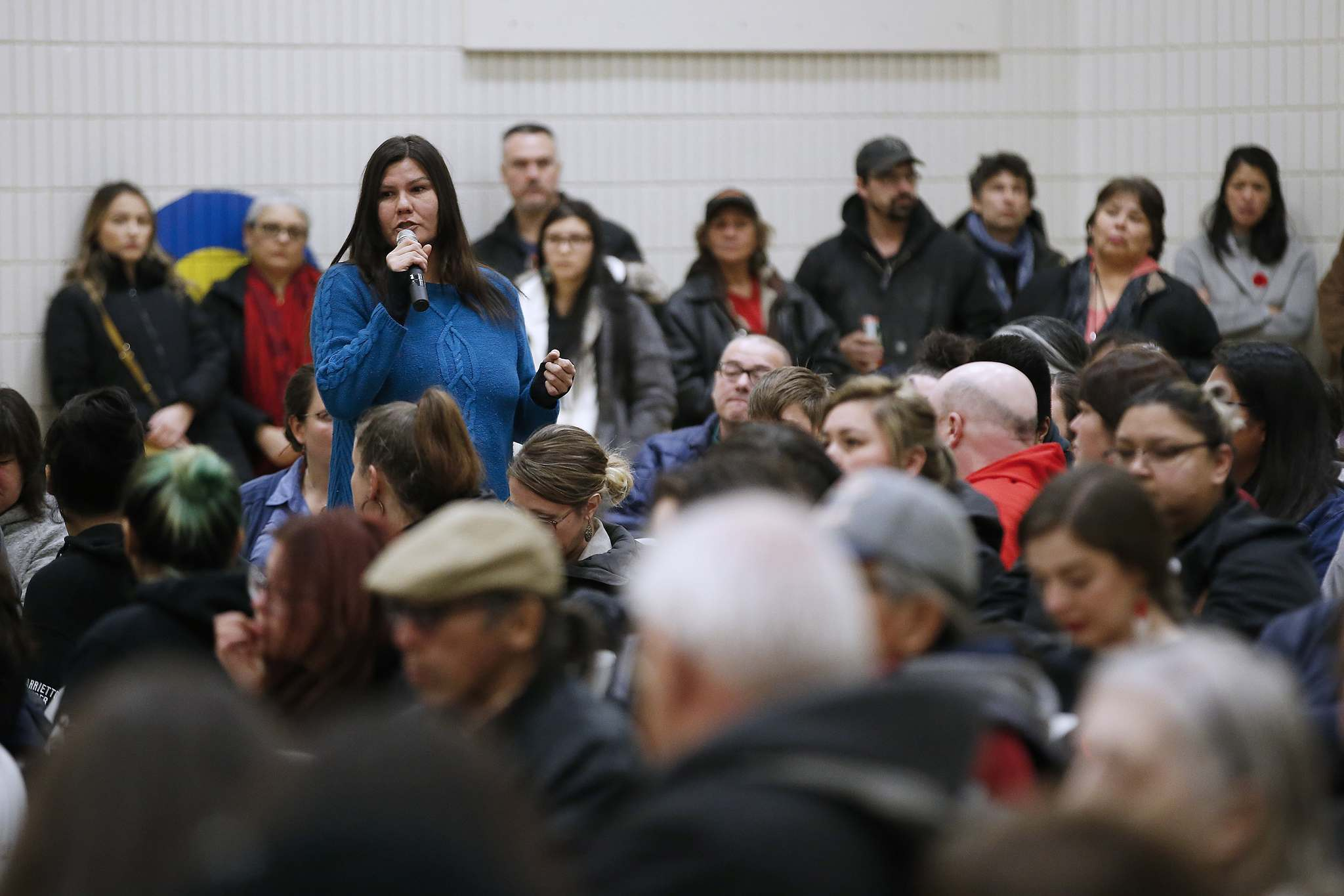 <p>Community member, Sabrina, speaks at a community gathering organized to talk about community issues at William Whyte School in Winnipeg's North End Wednesday.</p>