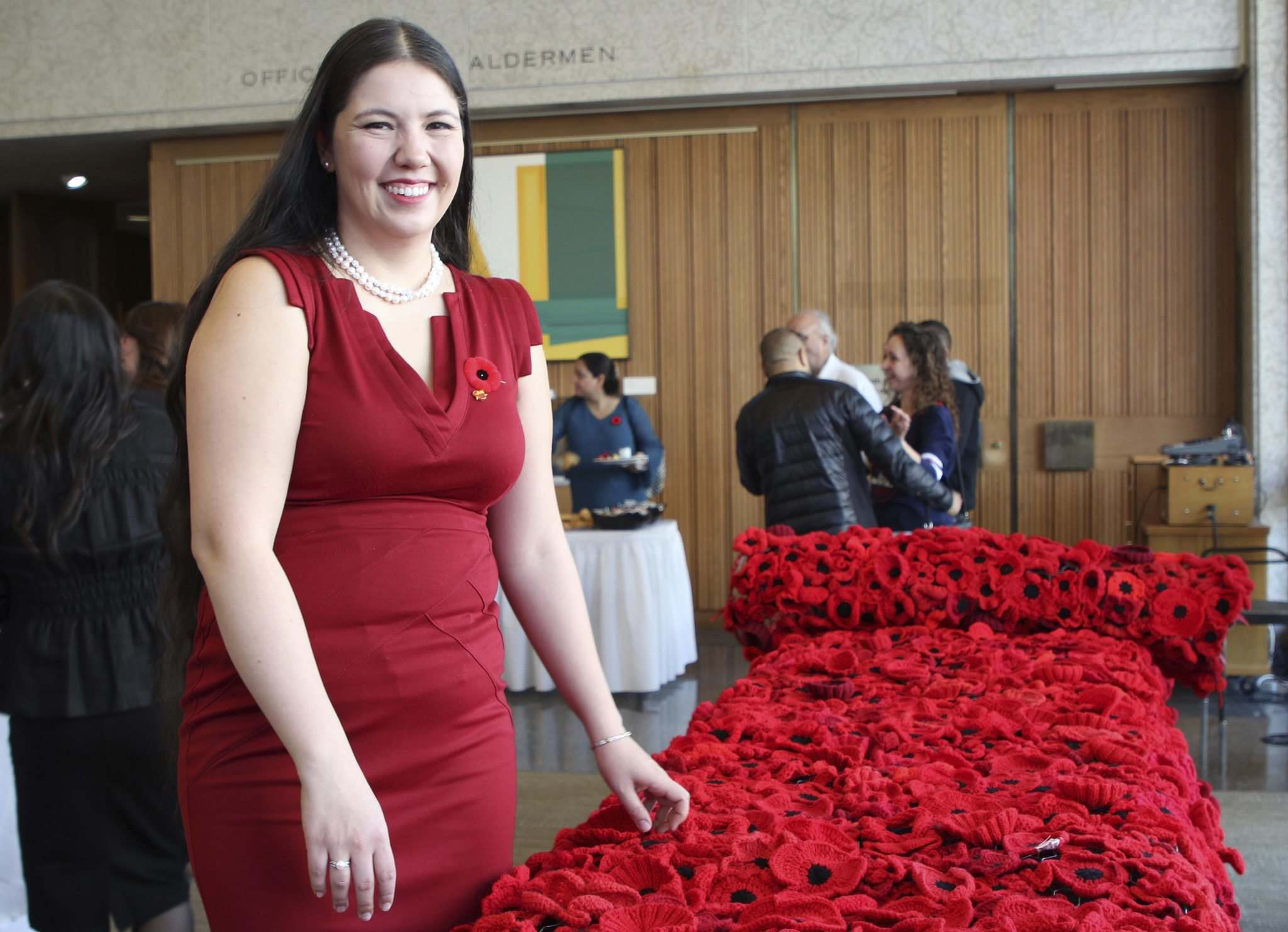 Sheilah Restall gathered her community to help stitch and sew handmade poppies to create a blanket of more than 8,000 handmade poppies ahead of Remembrance Day.