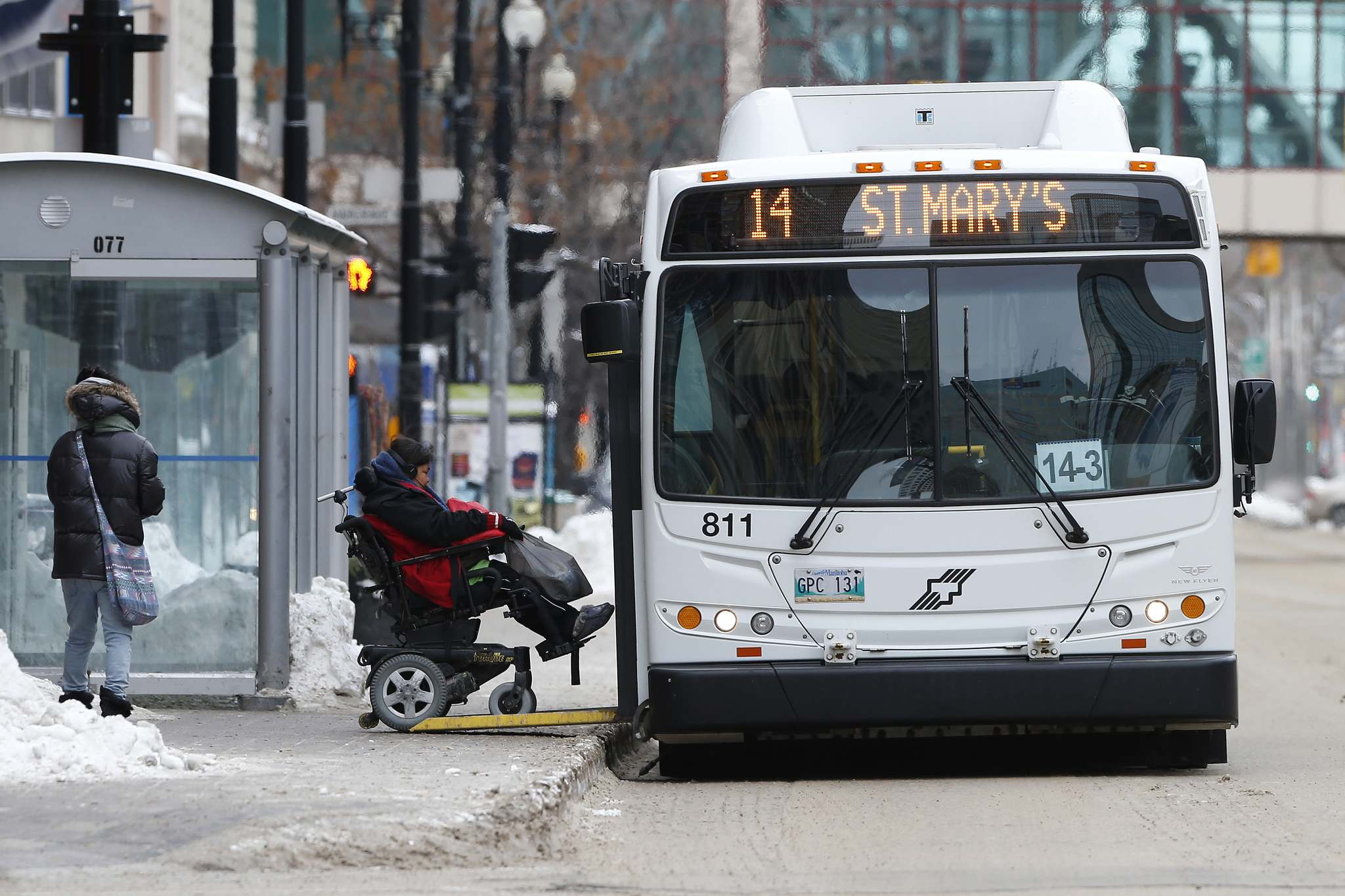 JOHN WOODS / WINNIPEG FREE PRESS FILES</p><p>A wheelchair-bound passenger gets on a city bus on Portage Avenue.</p>