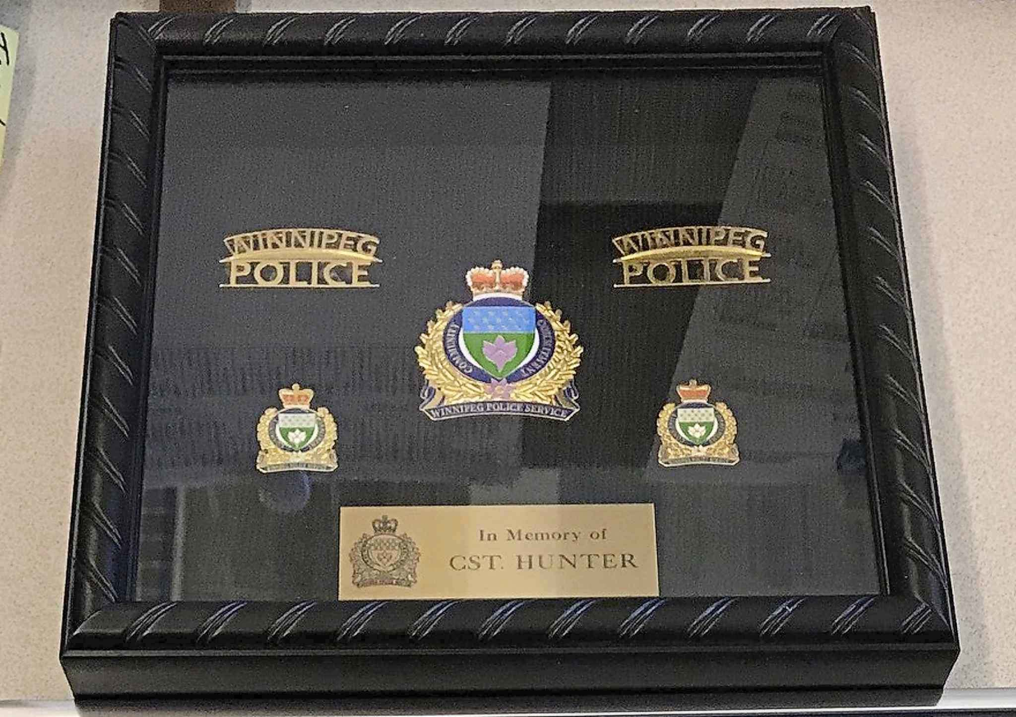A shadow box featuring brass from a police uniform was dedicated to the memory of Hunter Haze Straight-Smith during the three-year-old's funeral on Nov. 8, 2019. (Supplied photo)</p>