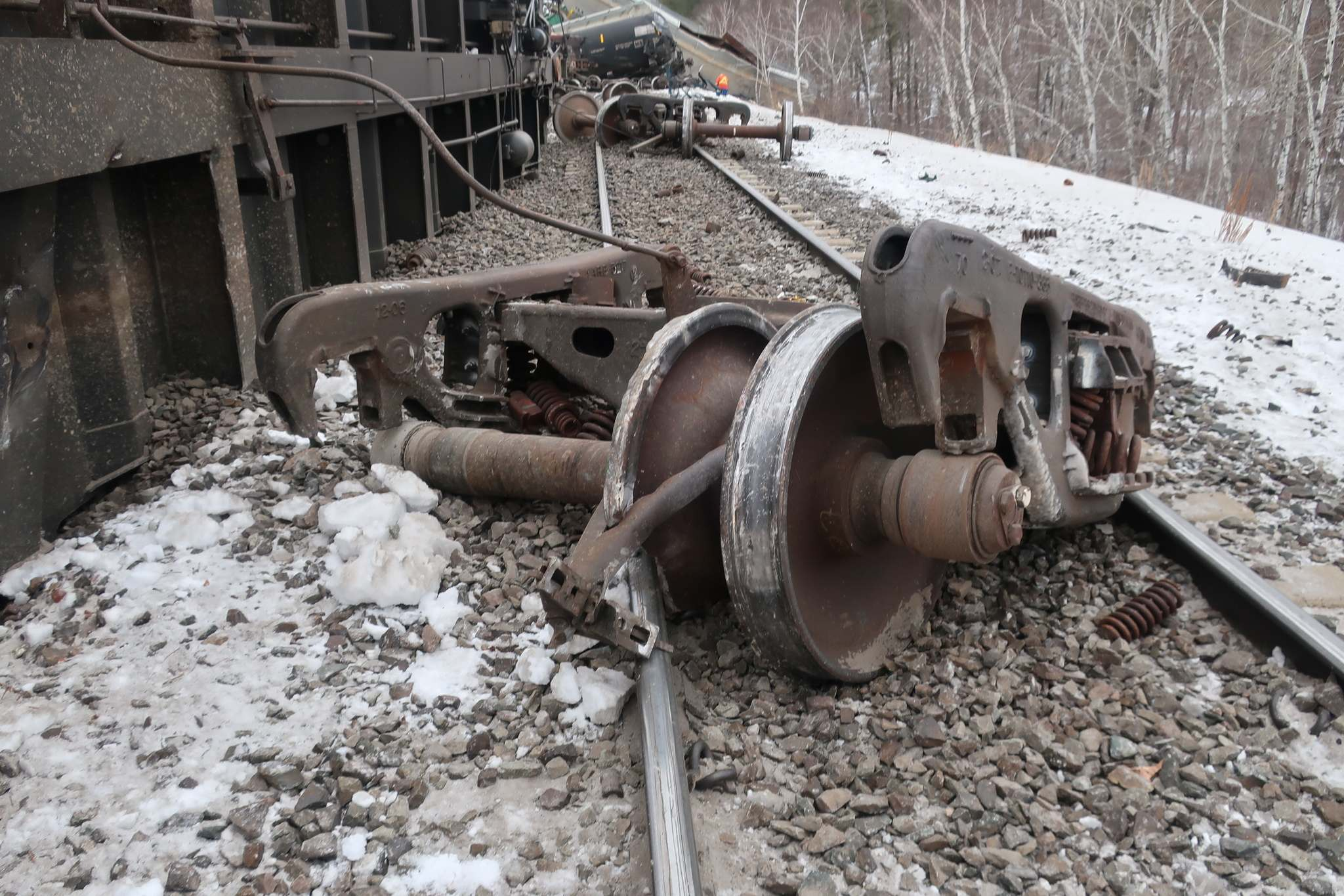 The train derailed at a speed of 80 km/h, as a result of a wheel that had cracked under its surface. (TSB photo)