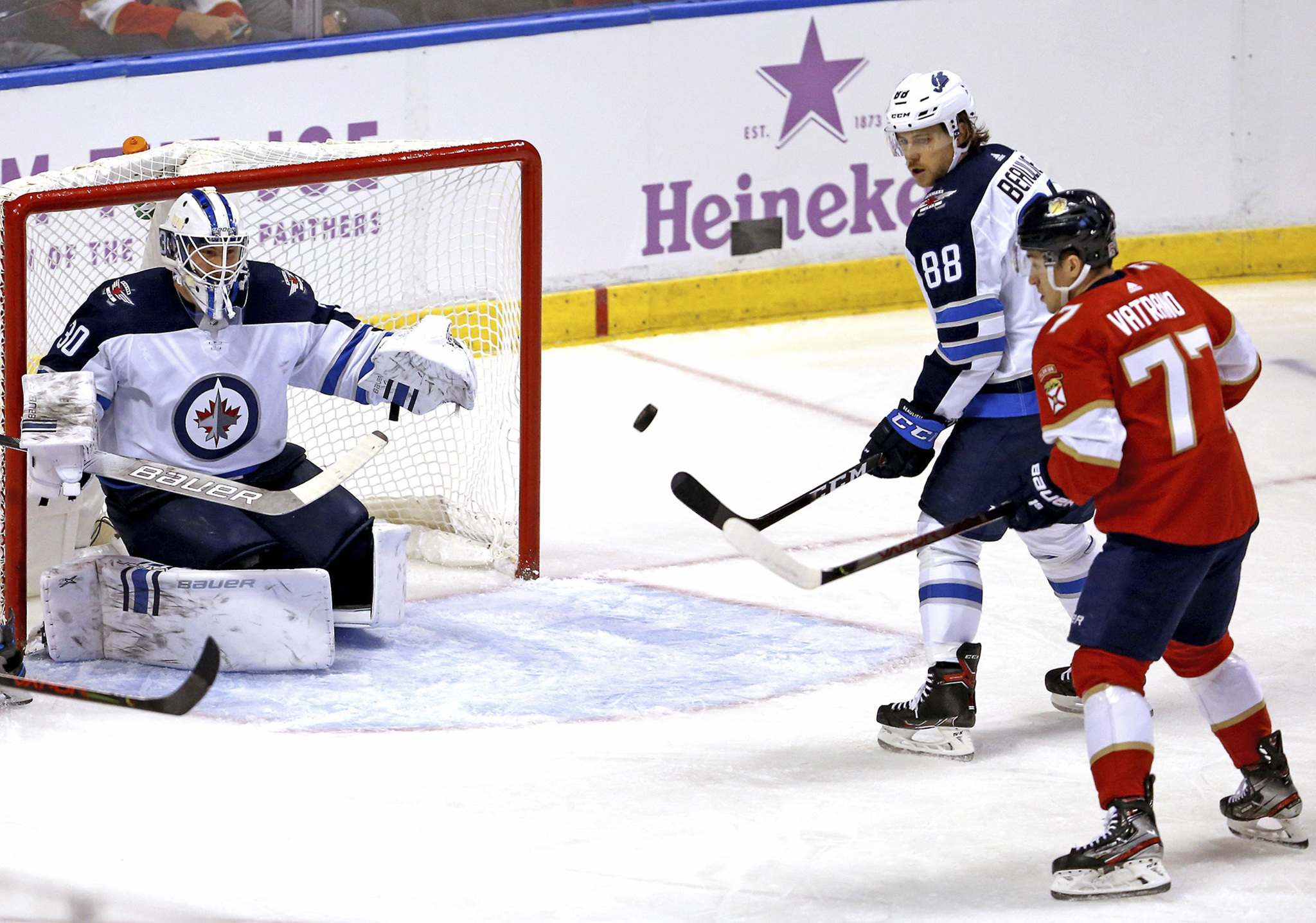 (David Santiago/Miami Herald)</p><p>Winnipeg Jets goalie Laurent Brossoit defends the net as teammate Nathan Beaulieu goes for the puck against the Florida Panthers' Frank Vatrano during the first period at the BB&T Center in Sunrise, Fla., on Thursday.</p>