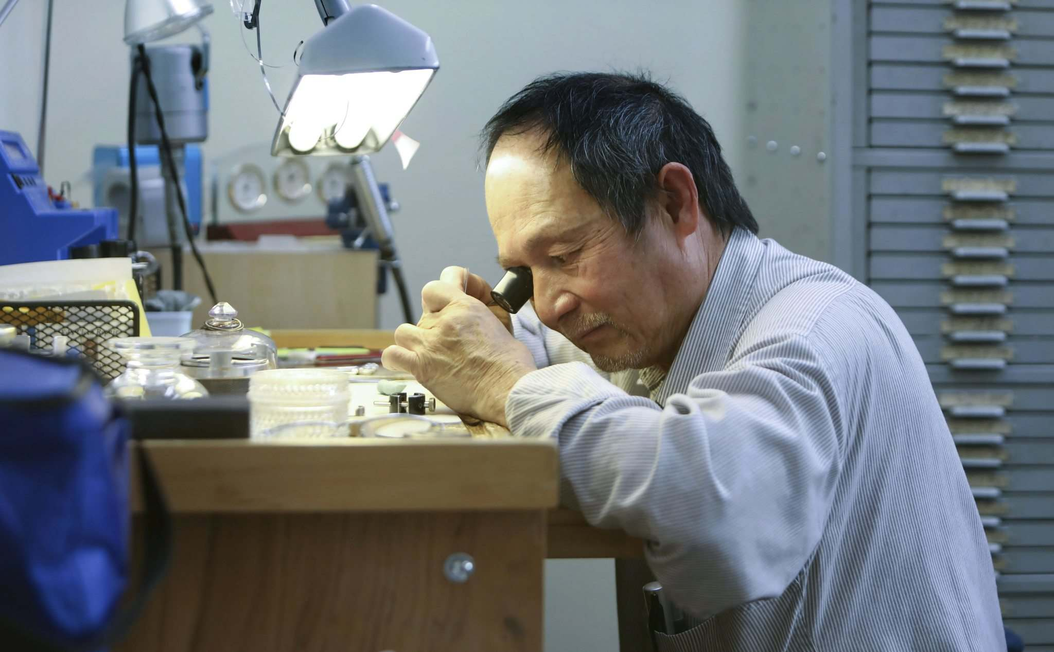 Tran has worked at Stewart's Horology, one of the city's few remaining independent watch-repair shops, since it opened. (Ruth Bonneville / Winnipeg Free Press)