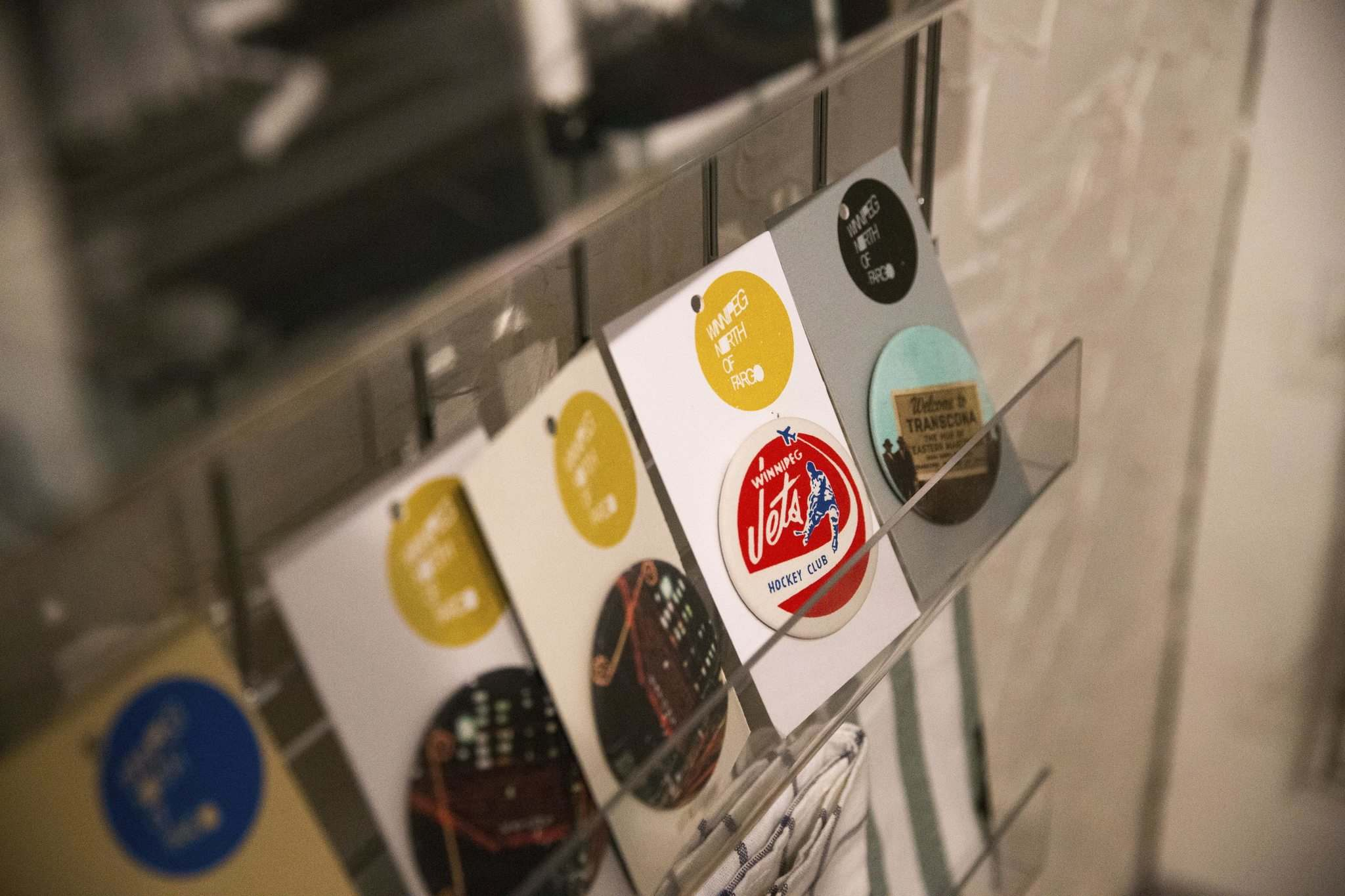 MIKAELA MACKENZIE / WINNIPEG FREE PRESS</p><p>Magnets, including one vintage Jets logo, are on display.</p>