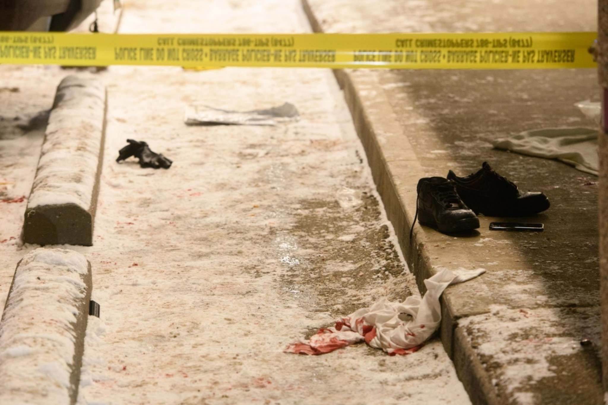 Mike Sudoma / Winnipeg Free Press</p><p>A bloody shirt on the ground in front of the 7-Eleven at the corner of Alrington St. and Ellice Ave. Thursday night.</p>
