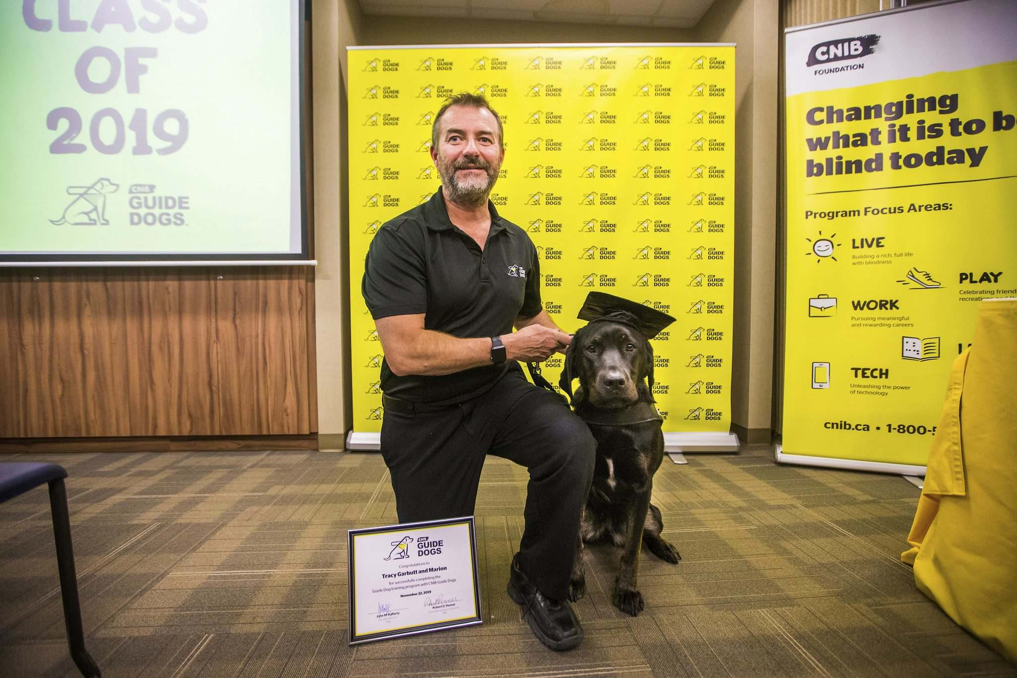 Handler Tracy Garbutt and Marion after receiving one of the first certificates from the Canadian National Institute's guide dog training program.  (Mikaela MacKenzie / Winnipeg Free Press)