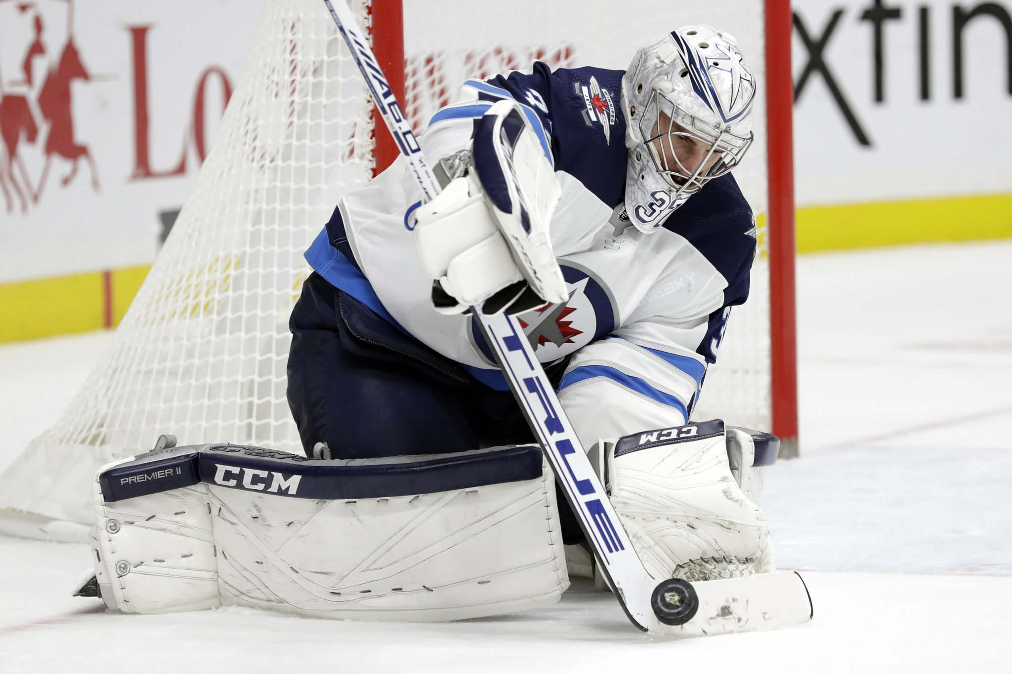 Connor Hellebuyck committed goalie theft larceny on Nov. 1 as the Jets stole a 3-2 win over San Jose despite being outshot 53-19. (Mark Humphrey / Associated Press files)</p>