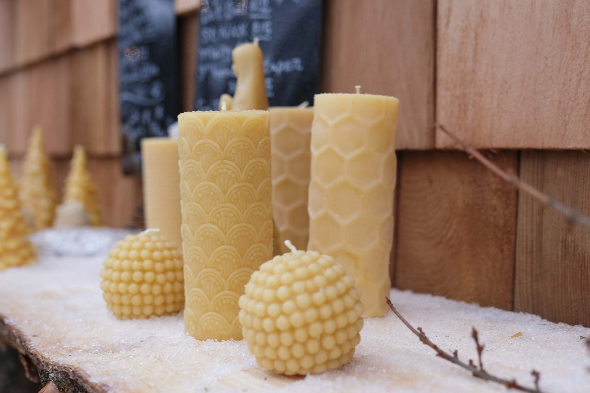 Along with Christmas trees, shoppers can also pick small items like locally made candles from Barletta Beeswax.