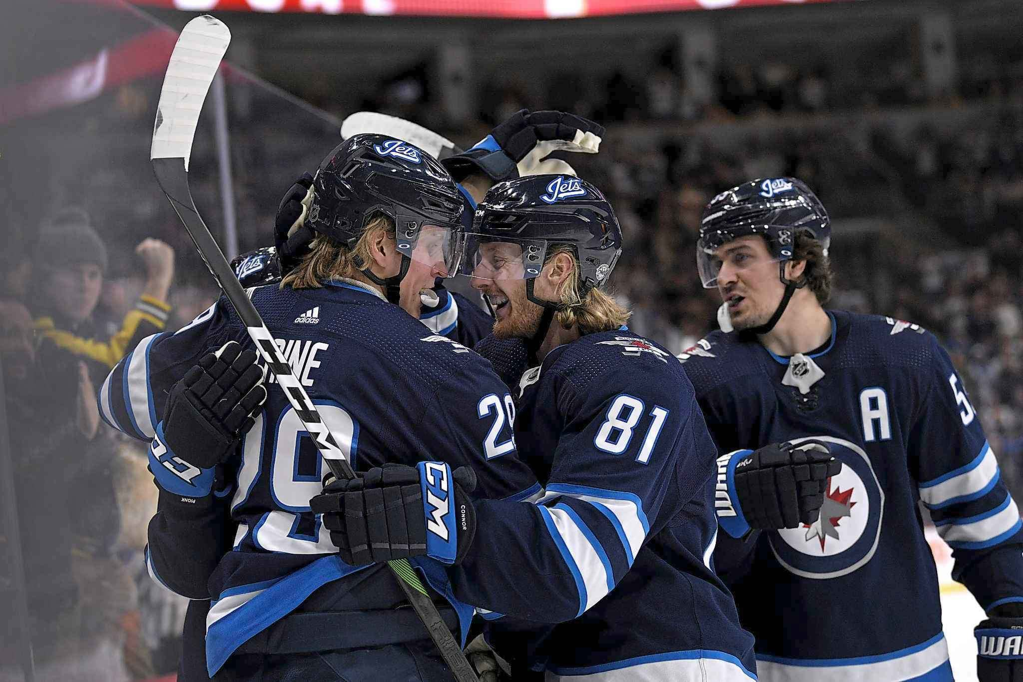 Laine celebrates his goal with his linemates. (Fred Greenslade / Canadian Press files)