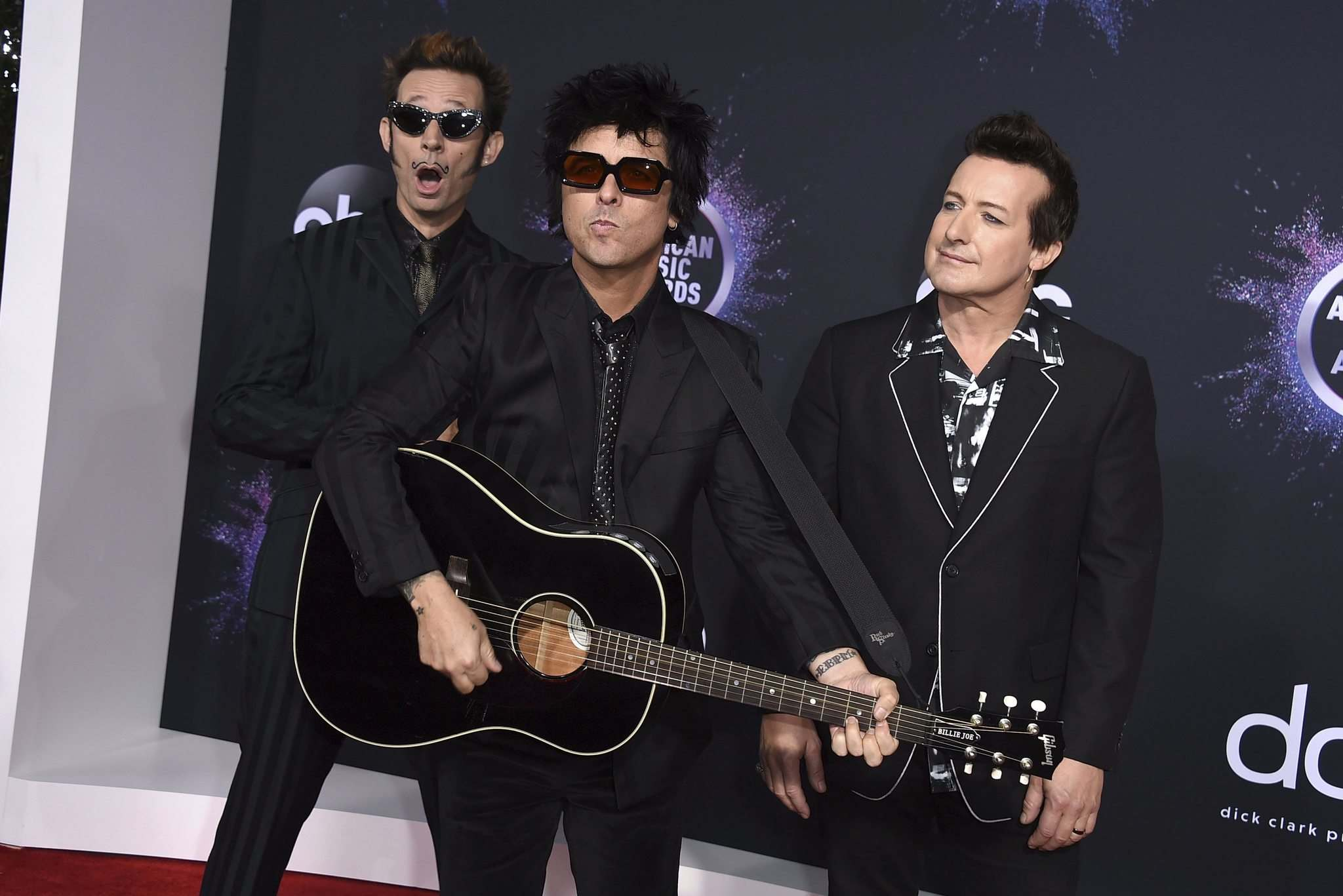 Mike Dirnt (from left), Billie Joe Armstrong and Tré Cool of Green Day are releasing an album in February 2020 titled Father of All Motherf---ers. (Jordan Strauss / Invision files)
