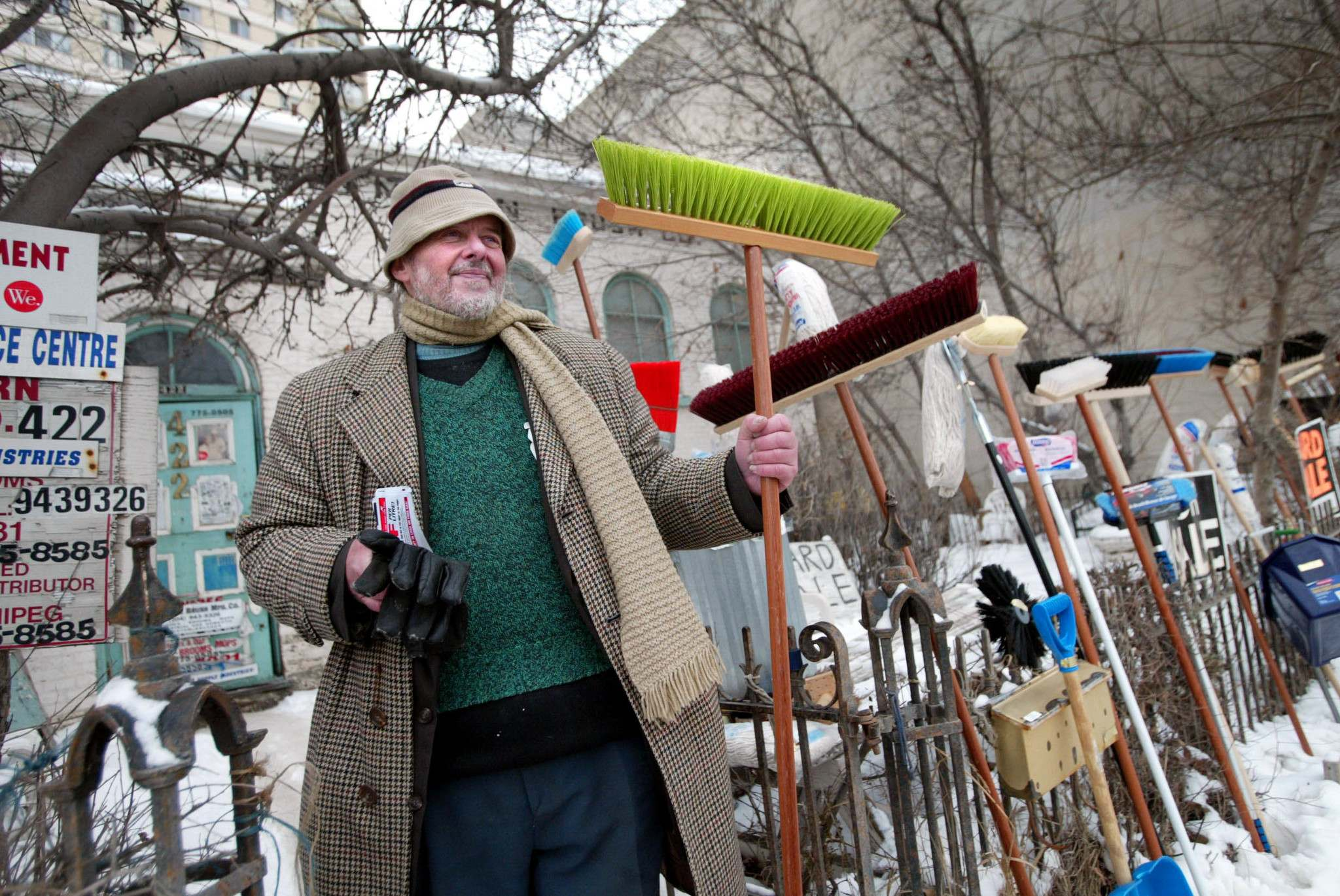 MIKAELA MACKENZIE / WINNIPEG FREE PRESS</p><p>Alexander Syzek, son of the founders of the Winnipeg Modern Brush Co., sells his family's wares in 2006 outside the building, which still displays the company's name.</p>