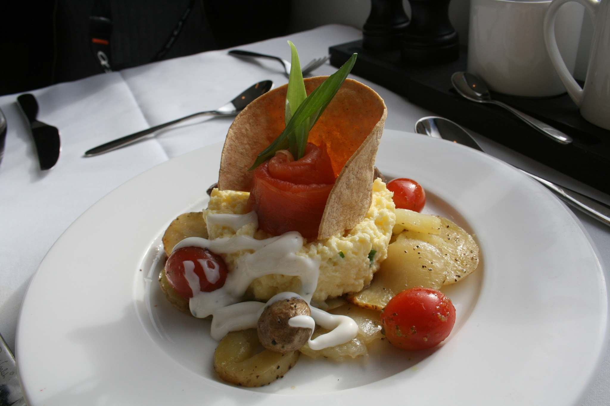 Fraser River smoked salmon and egg scramble served in a crispy corn tortilla with a side of Yukon Gold potatoes.</p></p>