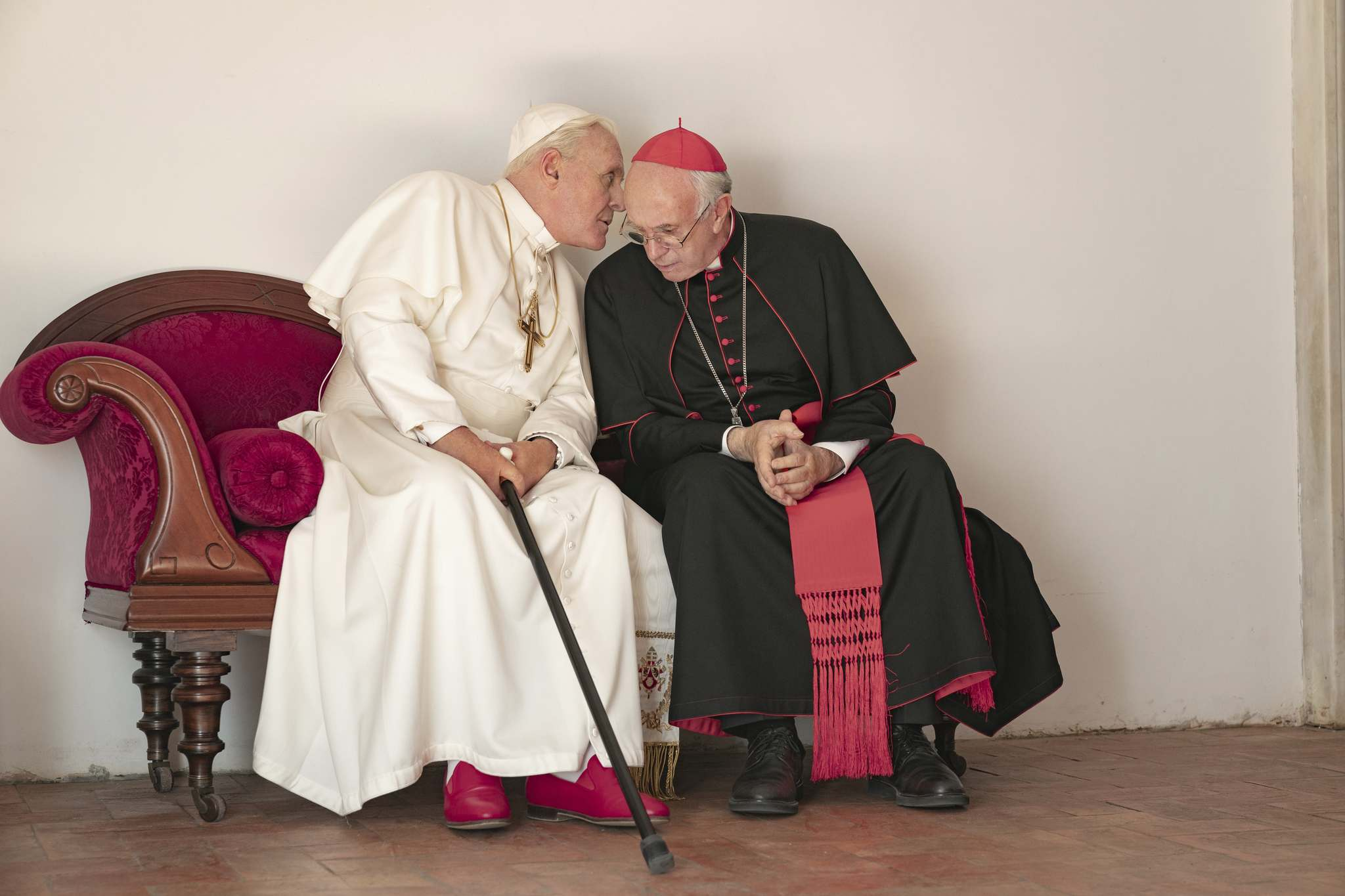 Peter Mountain/Netflix/TNS</p><p>Anthony Hopkins and Jonathan Pryce chat on-screen in 'The Two Popes' in a replica of the Vatican's Room of Tears.</p>