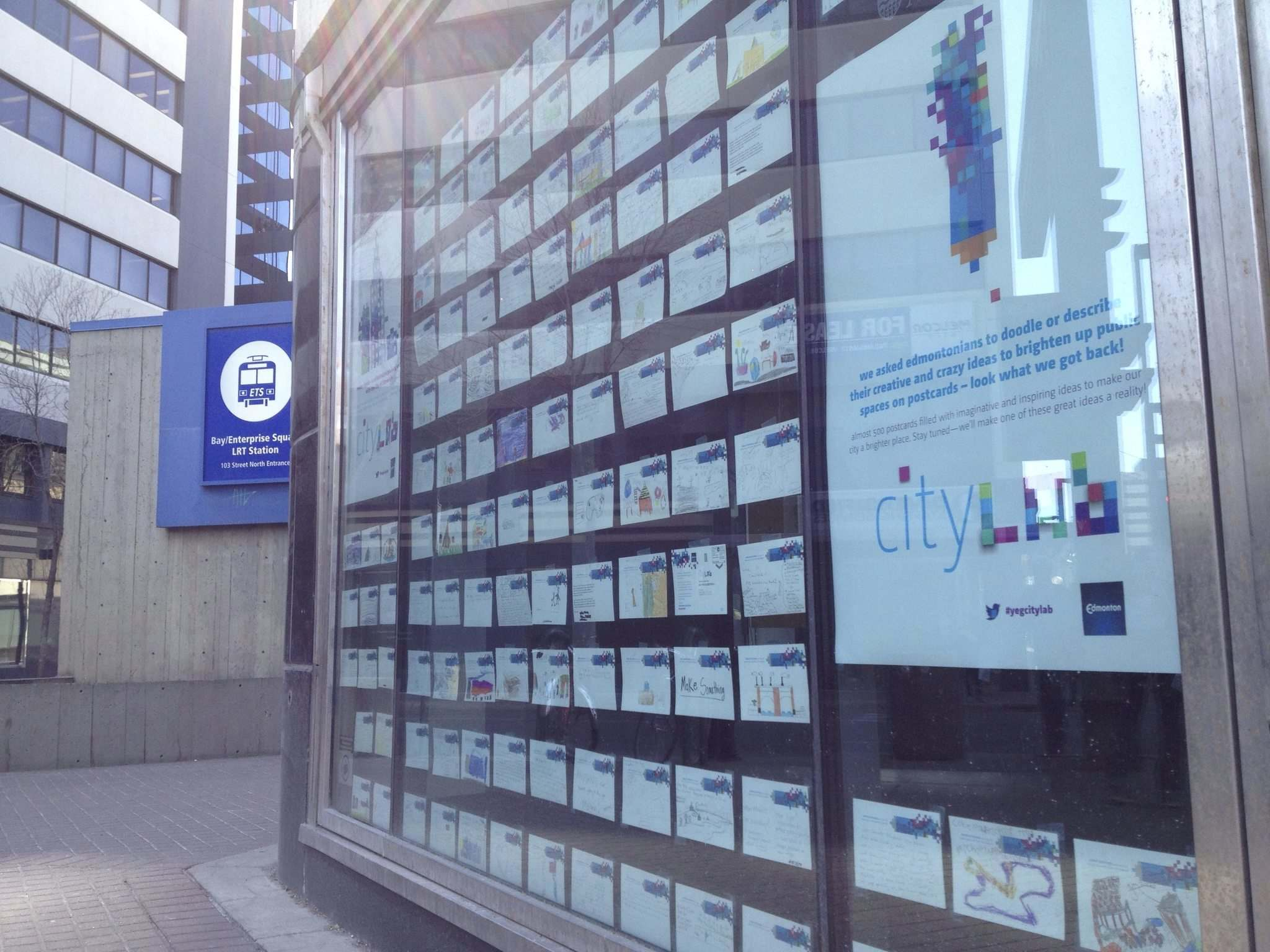 Placemaking ideas shared by Edmontonians via postcards, displayed in a vacant window downtown in 2015. (Marco Melfi)